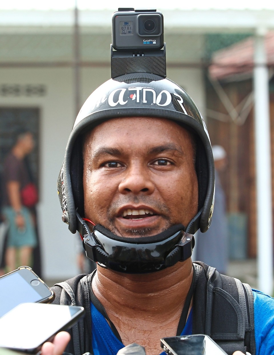 Mohd Nor is all smiles after making a safe landing.