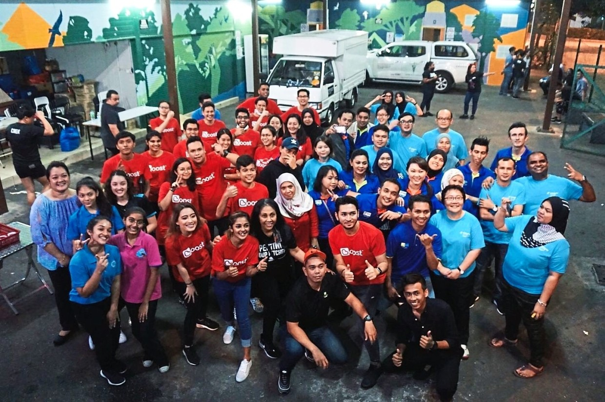 The Boost and Pertiwi Soup Kitchen team celebrating a job well done after the distribution.