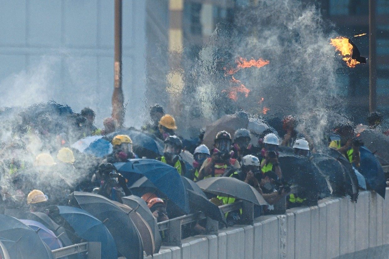 Public anger: The shortage of affordable housing is seen as a key factor that has sent thousands of youths onto the streets to join protesters in setting fires and throwing petrol bombs. — AFP