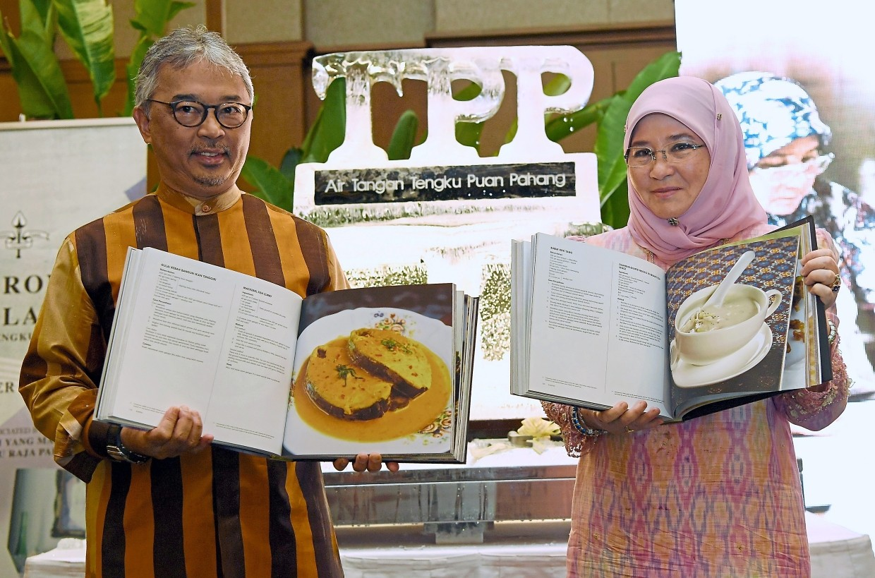 Tunku Azizah and Yang di-Pertuan Agong Al-Sultan Abdullah at the launch of Tunku Azizah's cookbooks in 2018. Tunku Azizah is passionate about preserving the traditional recipes of her home state Pahang. — Filepic