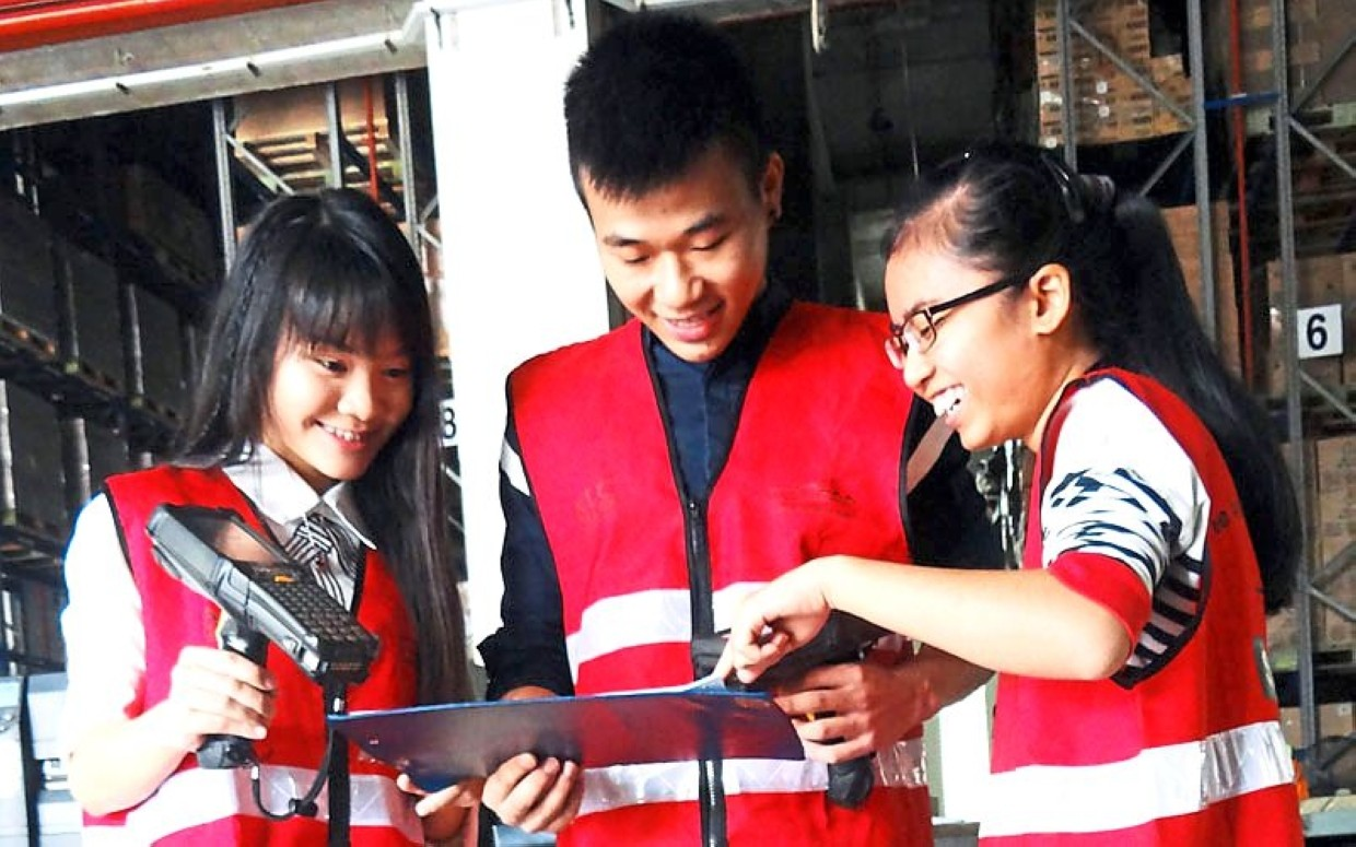 Work and learn: The Jom Bekerja Sambil Belajar programme gives students the opportunity to work part-time at PKT Logistics Group's warehouse, finance and human resources departments.