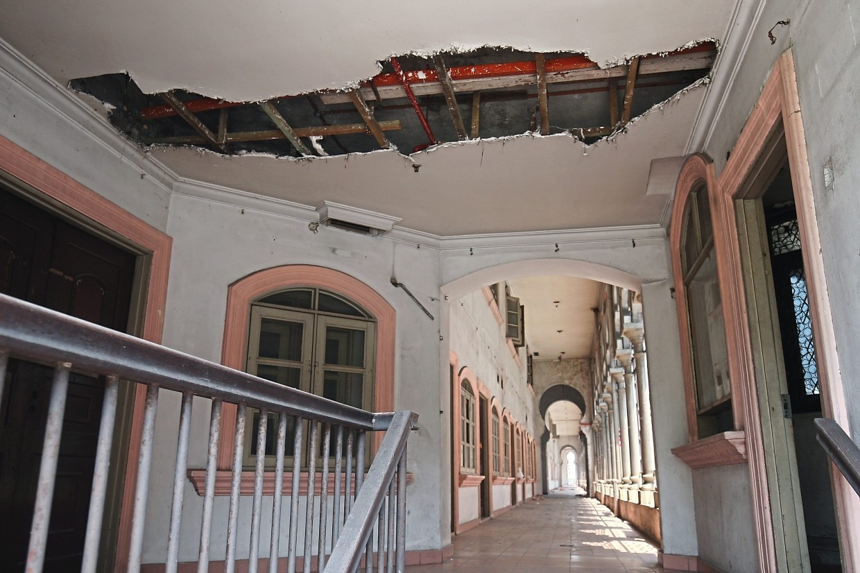 There are signs everywhere of the colonial buildings falling apart.