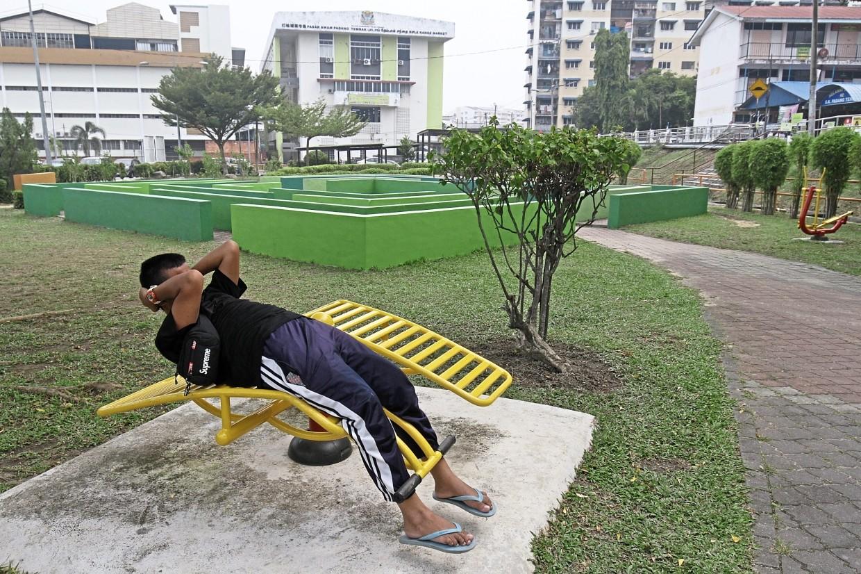 Mohd Ikmal Alif Abdullah, 14, using the equipment at the Linear Park in Taman Padang Tembak, Ayer Itam.