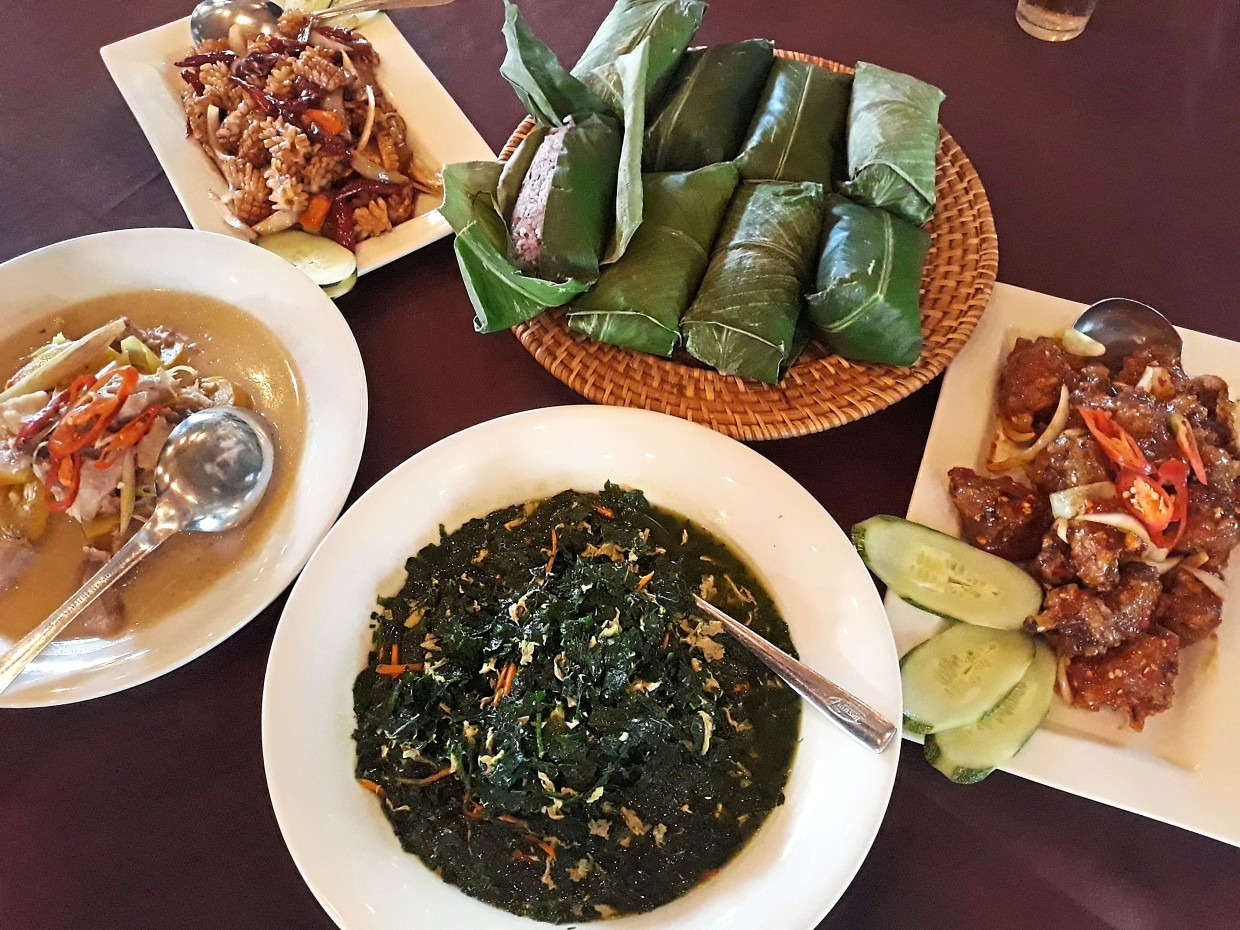 Lepau Restaurant in Jalan Ban Hock, Kuching serves local dishes such as (from left) Tilapia with Dayak Sour Eggplant, Dried Chilli Calamari, Brown Bario Rice wrapped in Itun Sip, Chilli Chicken and Stir-Fried Cangkuk Manis with Egg.