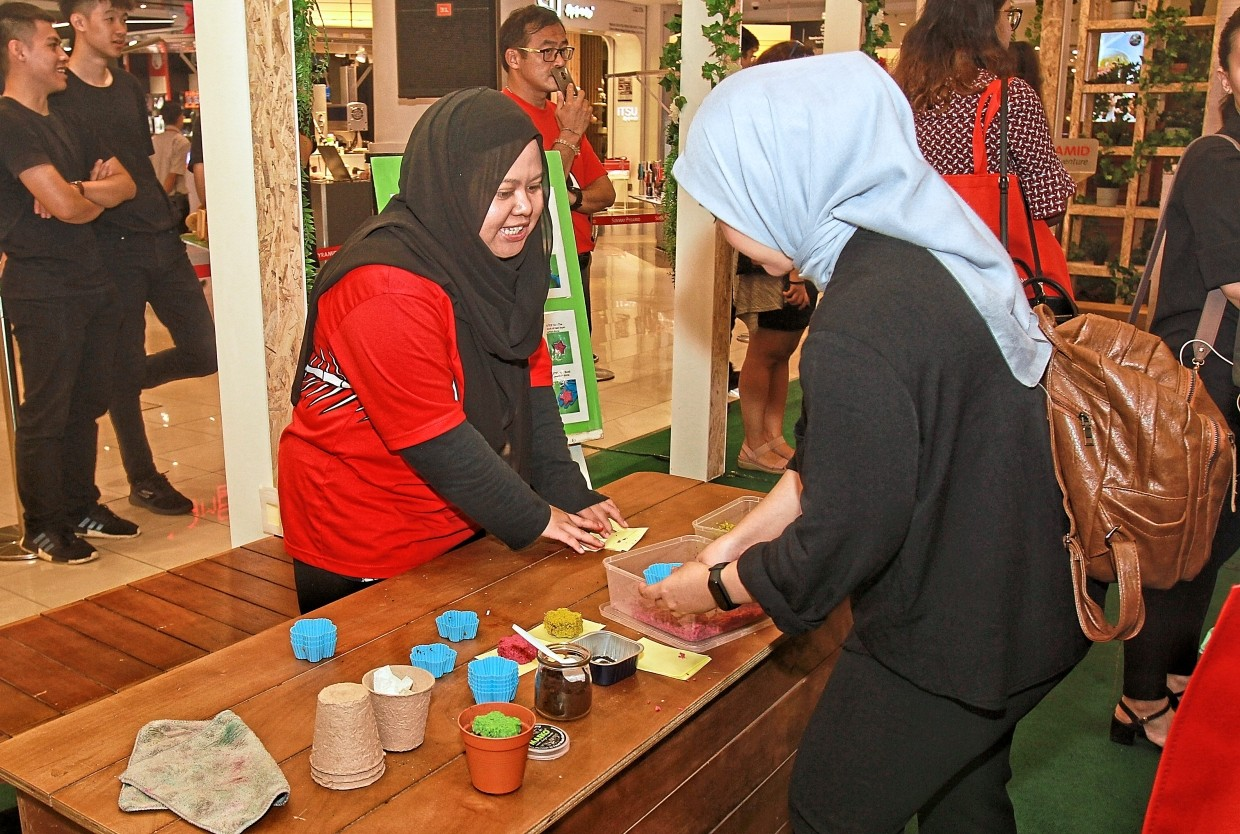 Shoppers get to participate in seed planting and pot decorating sessions, redeem seeds for planting and collect compost for gardening.