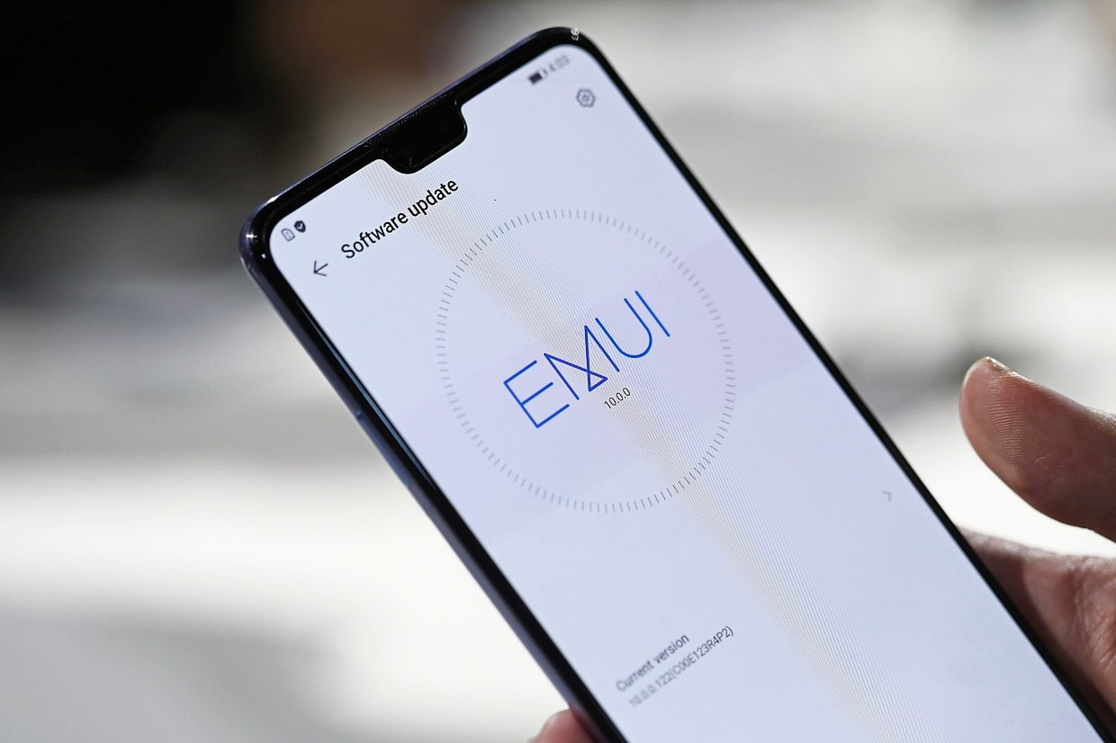 The EMUI10 logo sits on a software update screen display on a Huawei Mate 30 smartphone during the device's unveiling in Munich, Germany. — Bloomberg