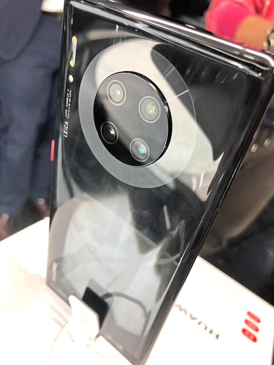 A quad-camera lens array sits on the back of a Mate 30 Pro smartphone. — KHOR SOW YEE/The Star