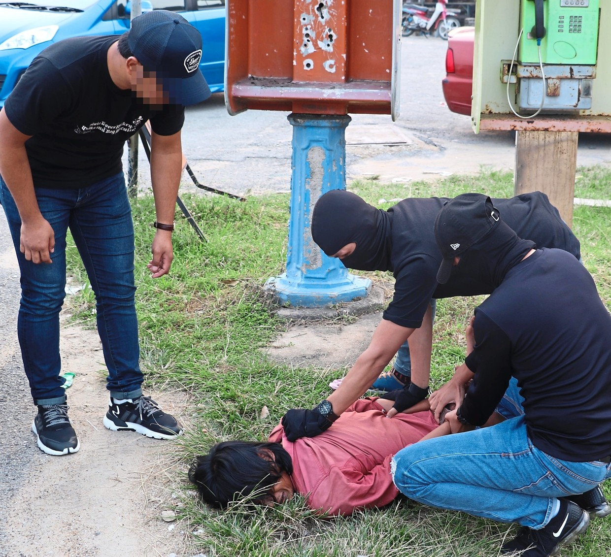 Officers detaining a suspect in a counter-terrorism swoop. The suspects are now being detained under Security Offences (Special Measures) Act 2012 (Sosma).