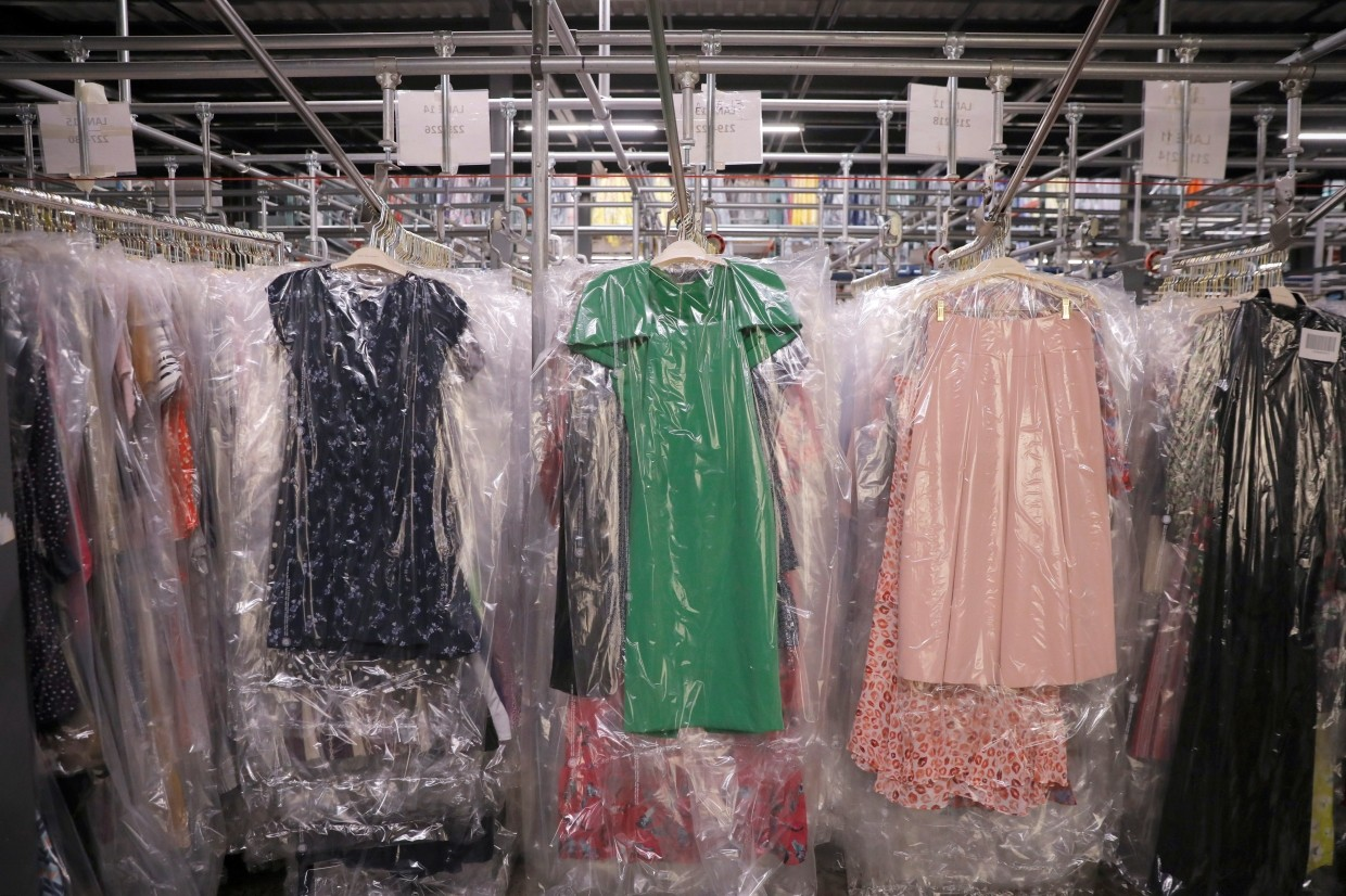 Garments hanging at Rent the Runway's 'Dream Fulfillment Center' in Secaucus, New Jersey, US. The integration of the new system wreaked havoc on fulfilment, impacting the number of orders that could be shipped each day.