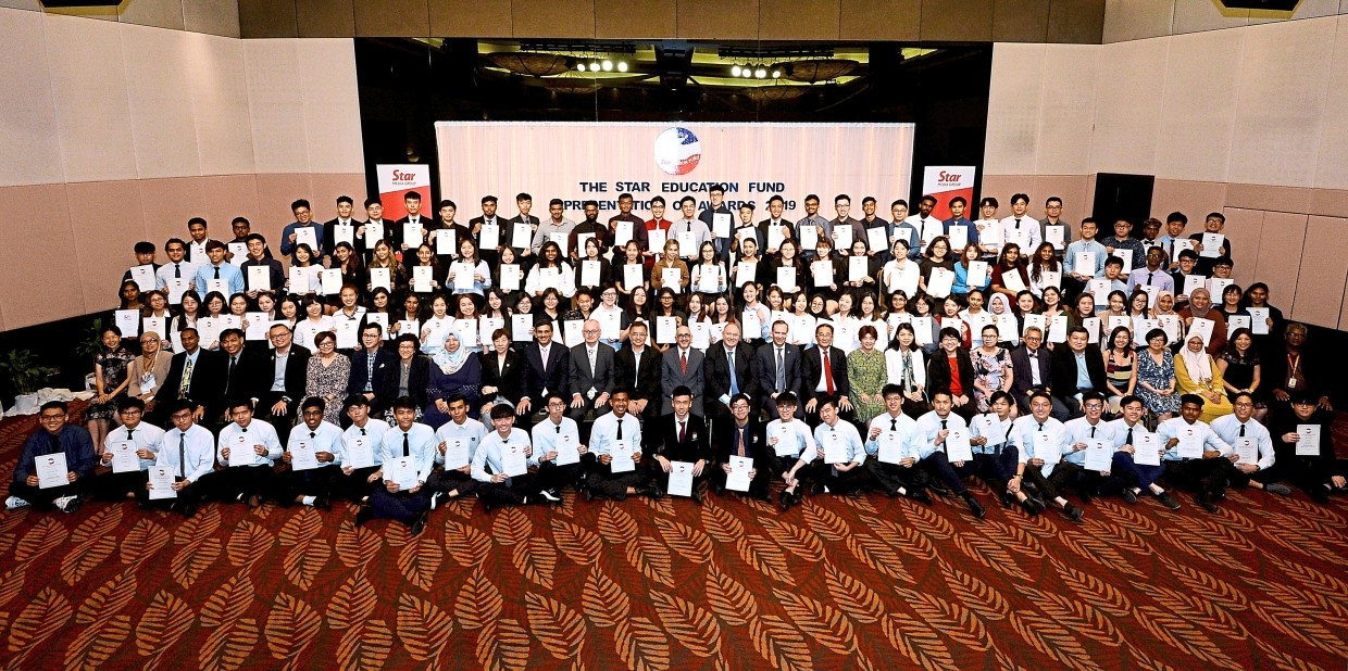 One for the album as Vogiatzakis (14th left, seated, second row), partners of the fund and this year's scholarship recipients at the presentation ceremony. — Photos: AZHAR MAHFOF & YAP CHEE HONG/The Star