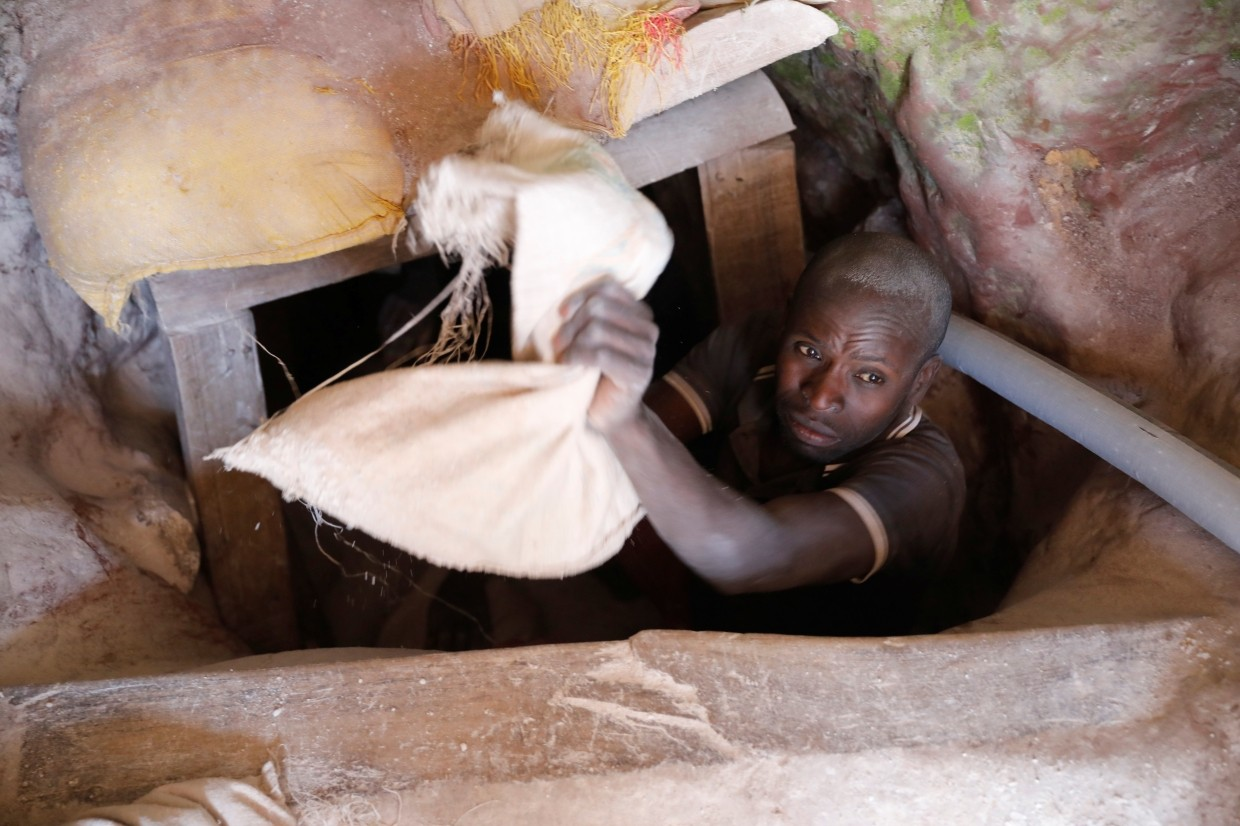 A miner works at the entrance of a shaft at the SMB coltan mine near the town of Rubaya in the Eastern Democratic Republic of Congo.