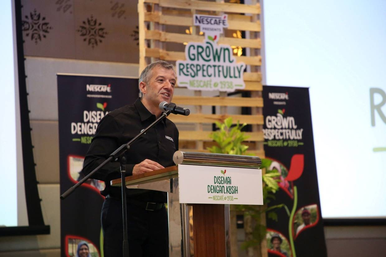 Mr Juan Aranols presenting his welcoming address at the launch of NESCAFÉ Grown Respectfully Programme.