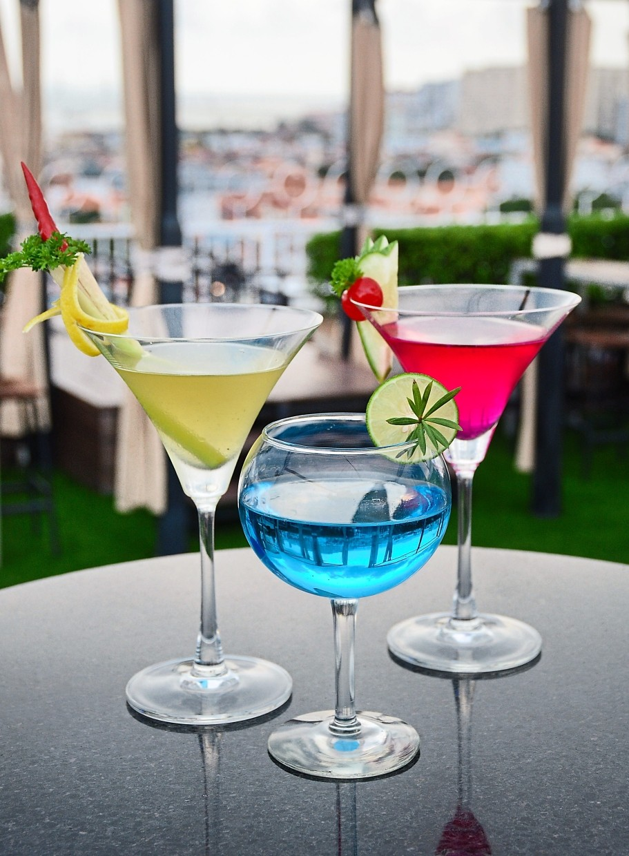 At the lush rooftop Skybar, guests can enjoy cocktails like (from left) Tom Yam Martini, Southside and Sexy Martini.