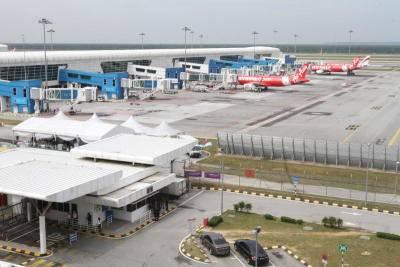 AirAsia planes are seen on the tarmac at klia2