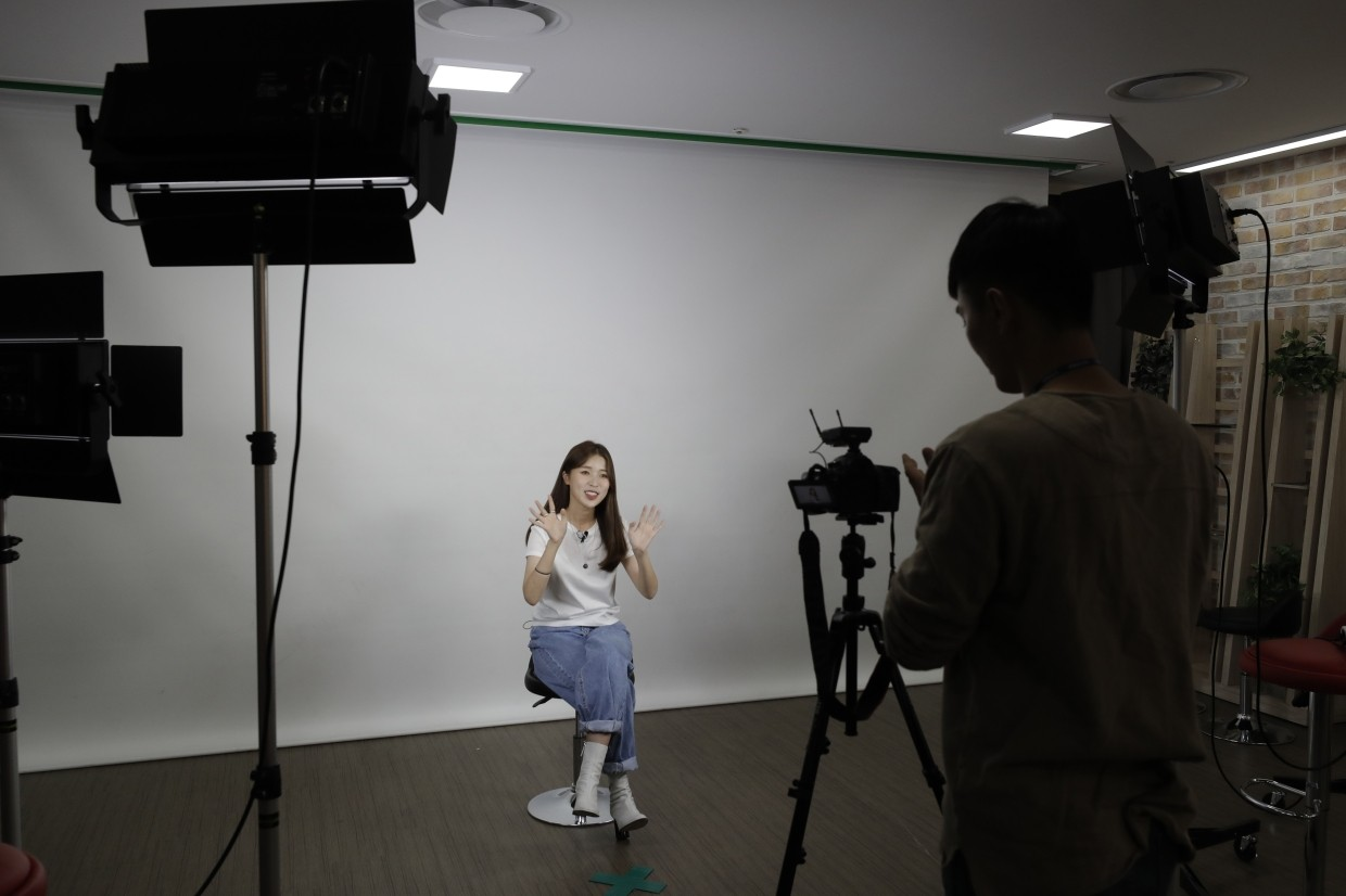 Kang waves her hands during a YouTube programme at a studio in Seoul, South Korea. In South Korea, a handful of young North Korean refugees have launched YouTube channels in recent years to offer a rare glimpse into life in the North.