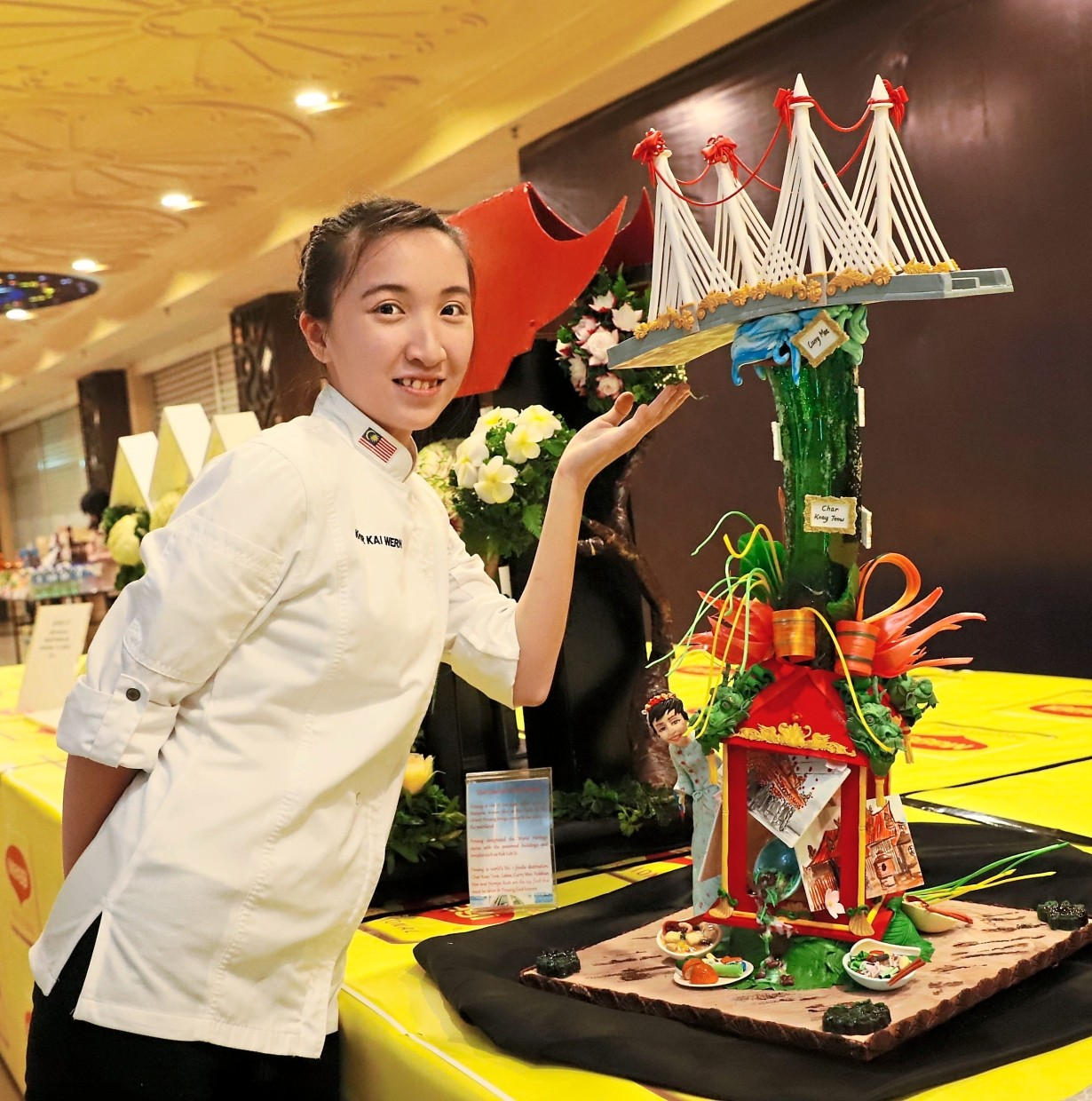 Winning creation: Khor showing her 'Pearl of the Orient' sugar showpiece for the 'Sugar Showpiece' category during the Battle of Global Chinese Chefs 2019 at M Mall in Penang Times Square, George Town.