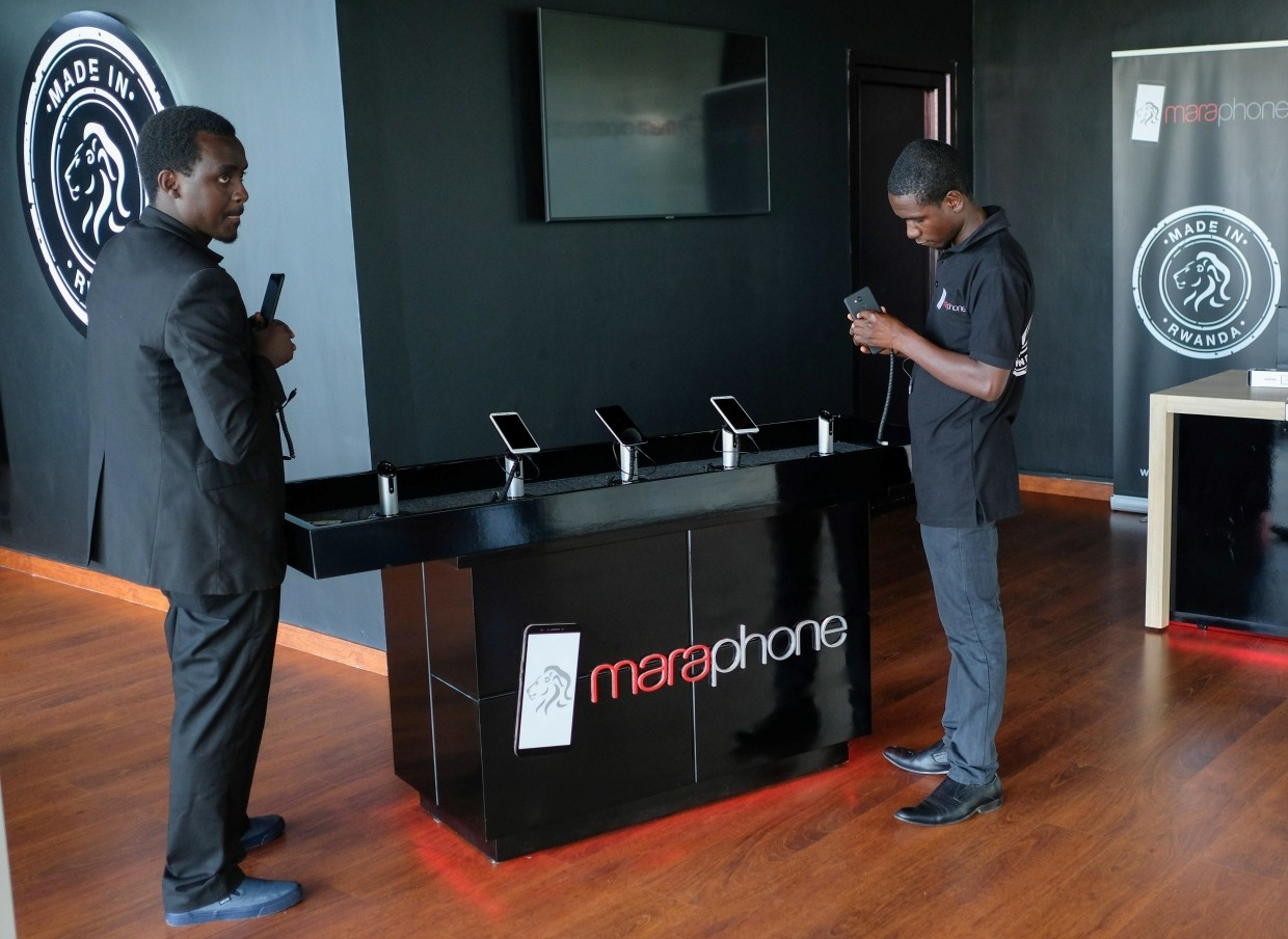 Workers displaying the Mara X and Mara Z smartphones during their launch by Rwanda's Mara Group in Kigali, Rwanda.