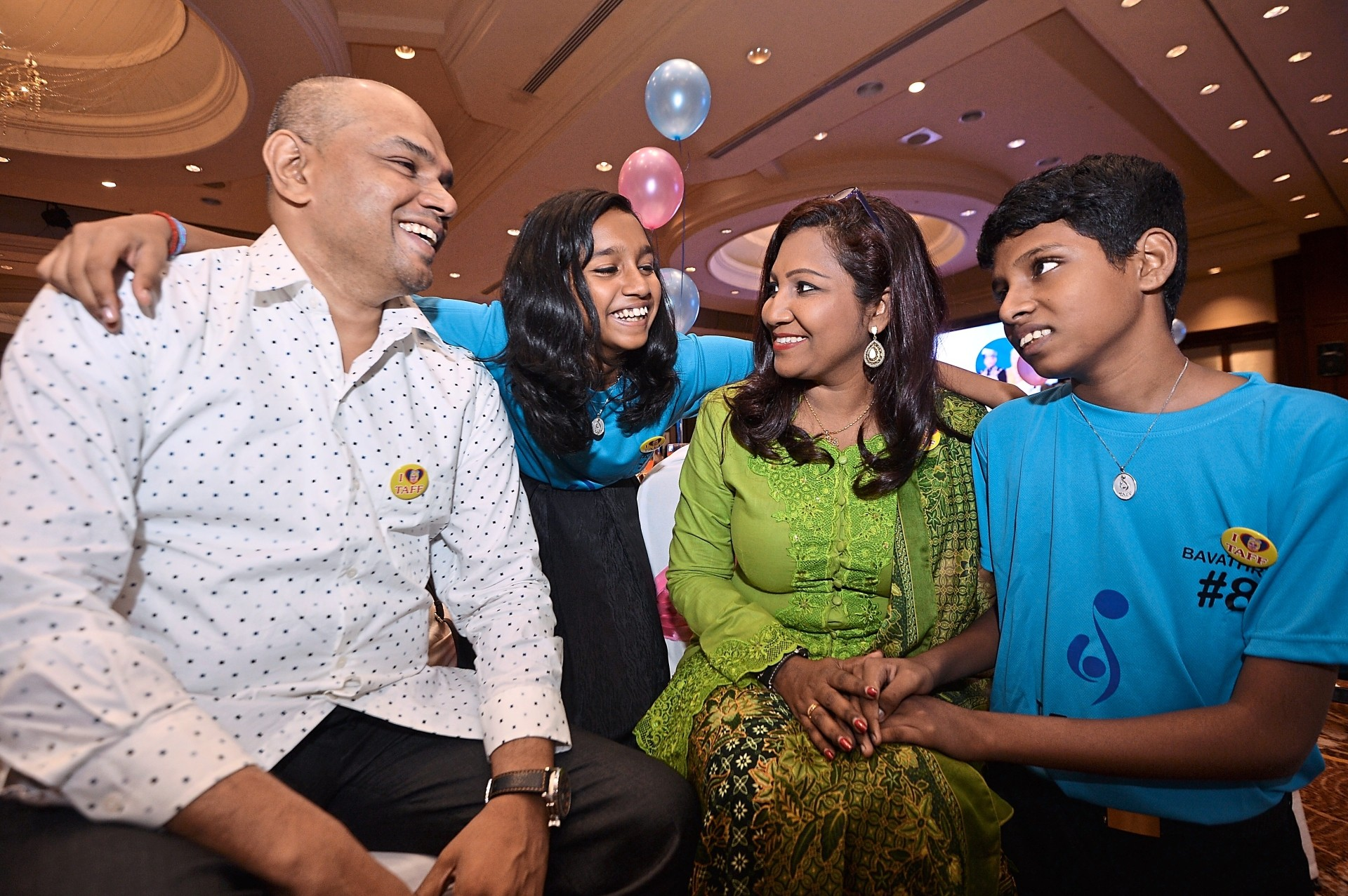 Yogendran (second from right) with her twins and husband at the event.