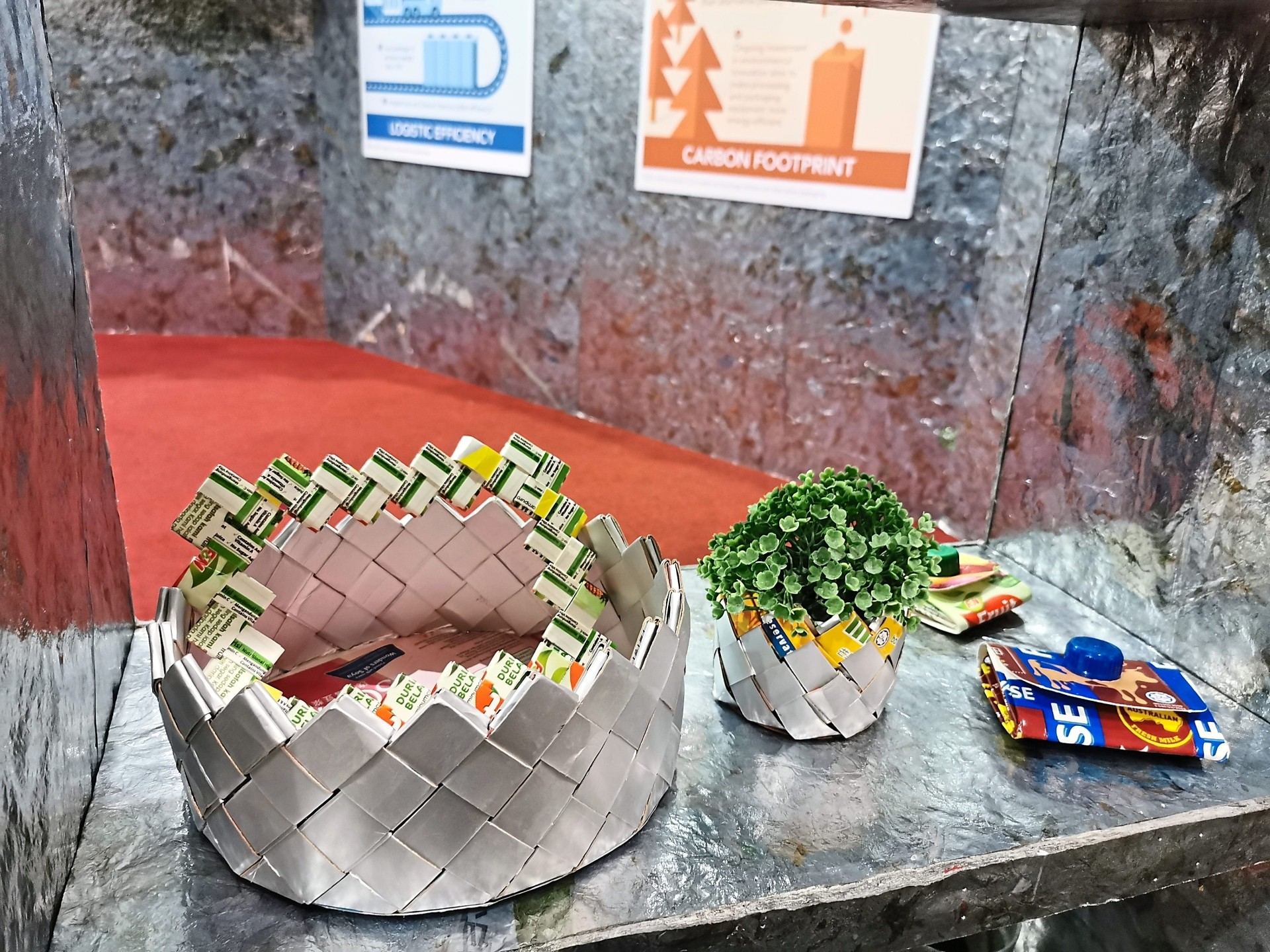 Examples of upcycling — flower basket made from reusing waste paper and beverage carton.