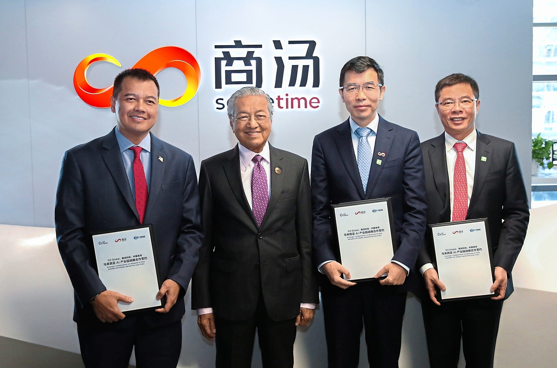 (From left) G3 Global Bhd executive chairman Datuk Wan Khalik Wan Muhammad, Prime Minister Tun Dr Mahathir Mohamad, SenseTime Group Ltd founder Prof. Tang Xiao'ou and China Harbour Engineering Company Ltd chairman Lin Yi Chong after the signing ceremony of the Memorandum of Understanding (MoU) for the setting up of an AI park in Malaysia at SenseTime's office in Beijing in April 2019. - Filepic