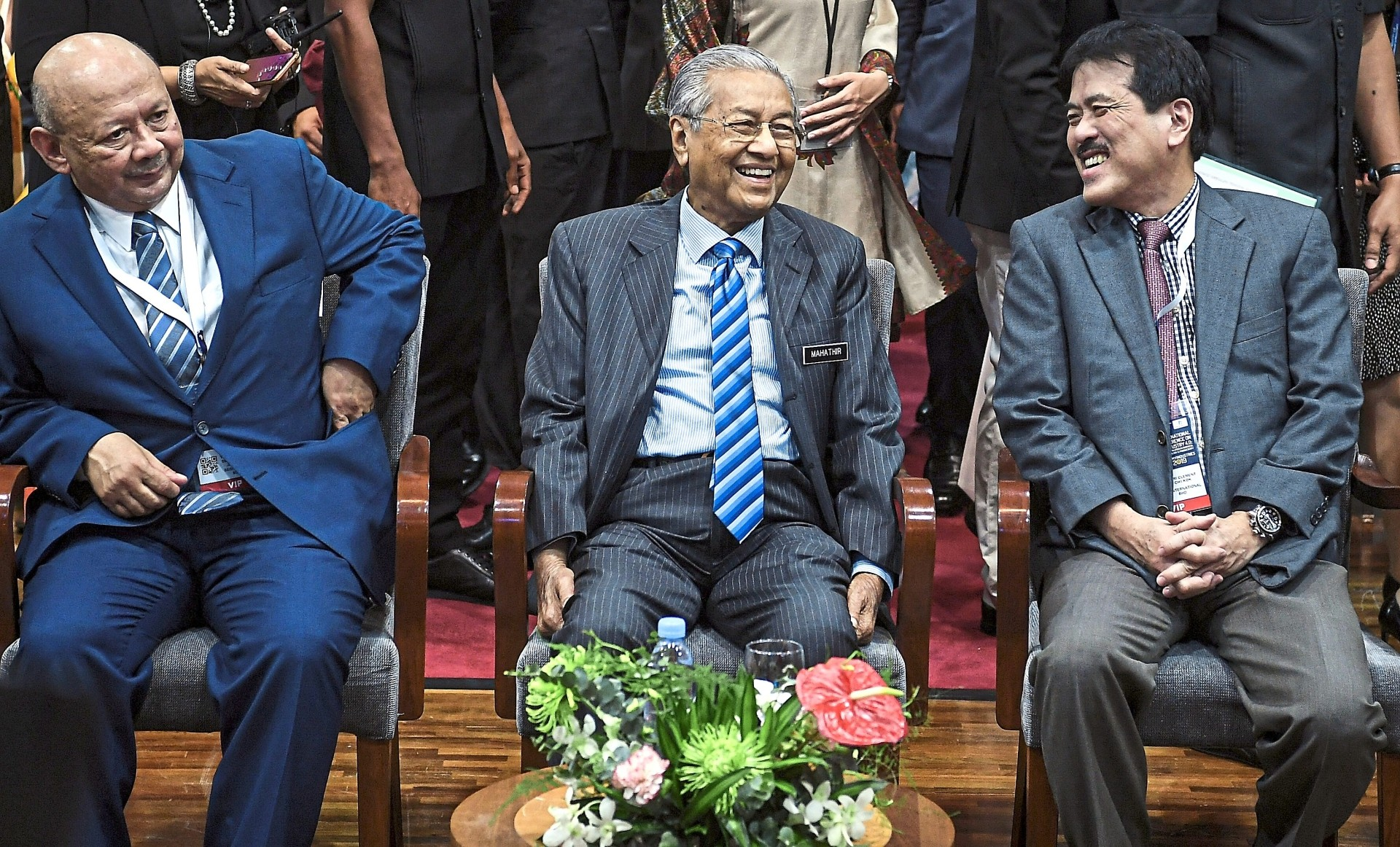 All smiles: Dr Mahathir (centre) sharing a light moment with SEGi University & Colleges group managing director Tan Sri Clement Hii Chii Kok (right) at SEGi University. Looking on is SEGi University chancellor Tan Sri Syed Anwar Jamalullail. — Bernama