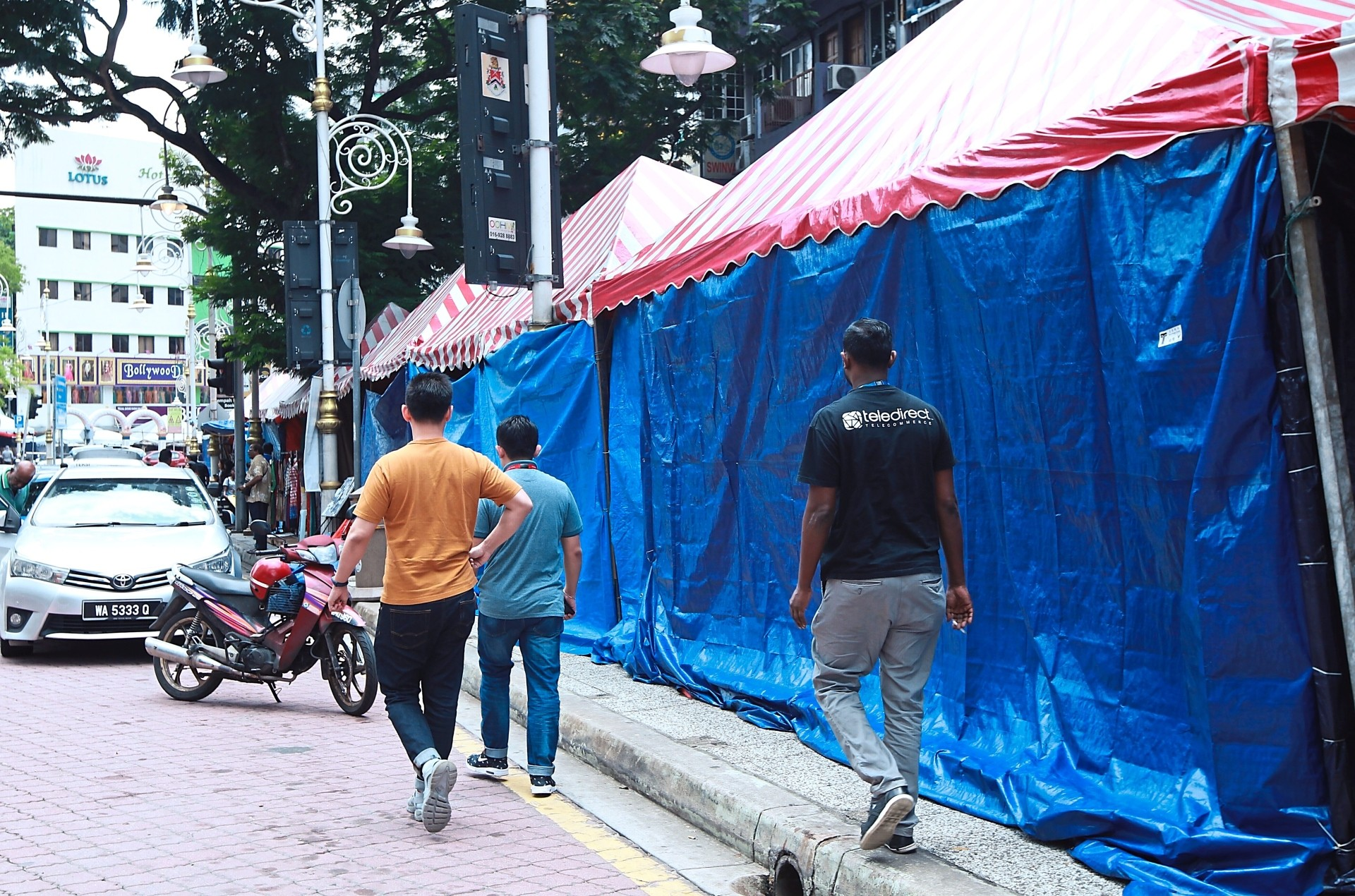 Members of the public have to watch where they walk as the festive bazaar lots have extended to the edge of the road.