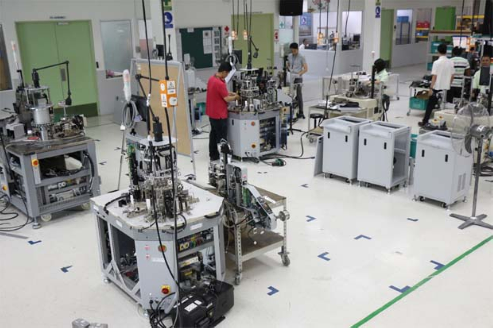 Pentamaster technicians working on test equipment to be used in the automotive and semiconductor industries. - Filepic