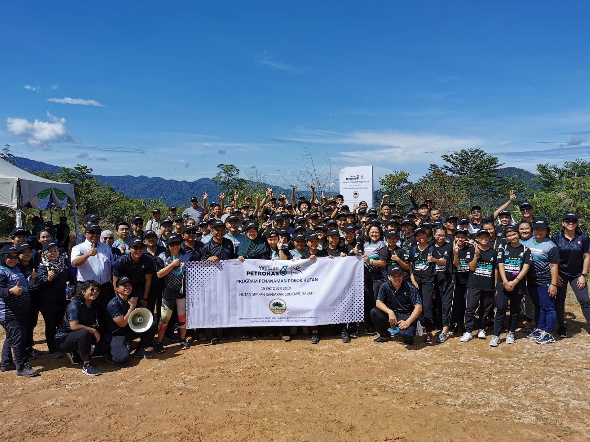 A group photo of some of the 150 volunteers, including students from St Michael's Secondary School, who were involved in the Sentuhan Alam programme.