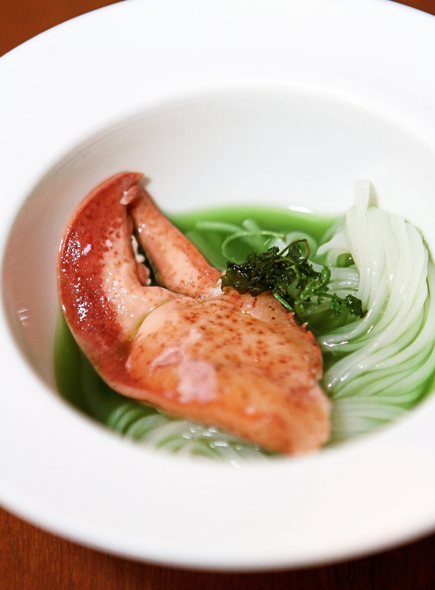 Local watercress is pureed for the Cold Inaniwa with Lobster, Watercress Soup.