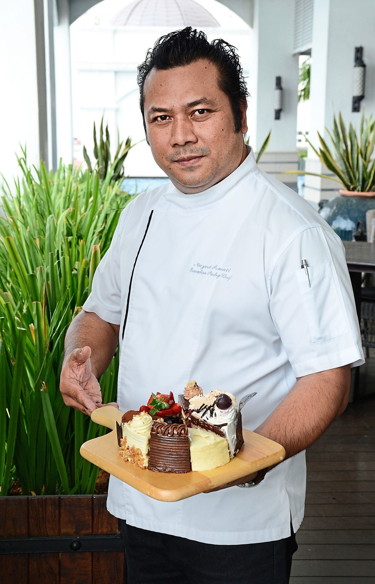 Chef Nazeri showing the variety  of cakes also available in slices.