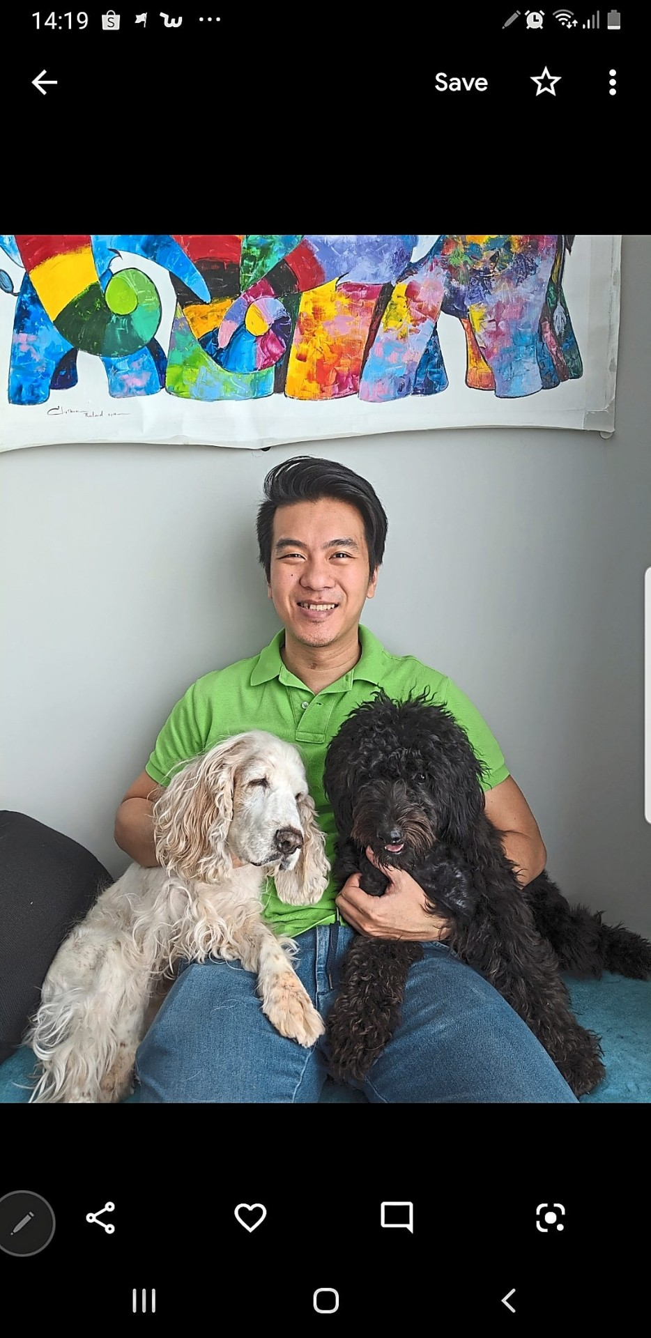 Seen here with his dogs, Tan says proceeds from the dog food sales will go towards canine welfare projects at the charity-driven event in Bandar Utama tomorrow.