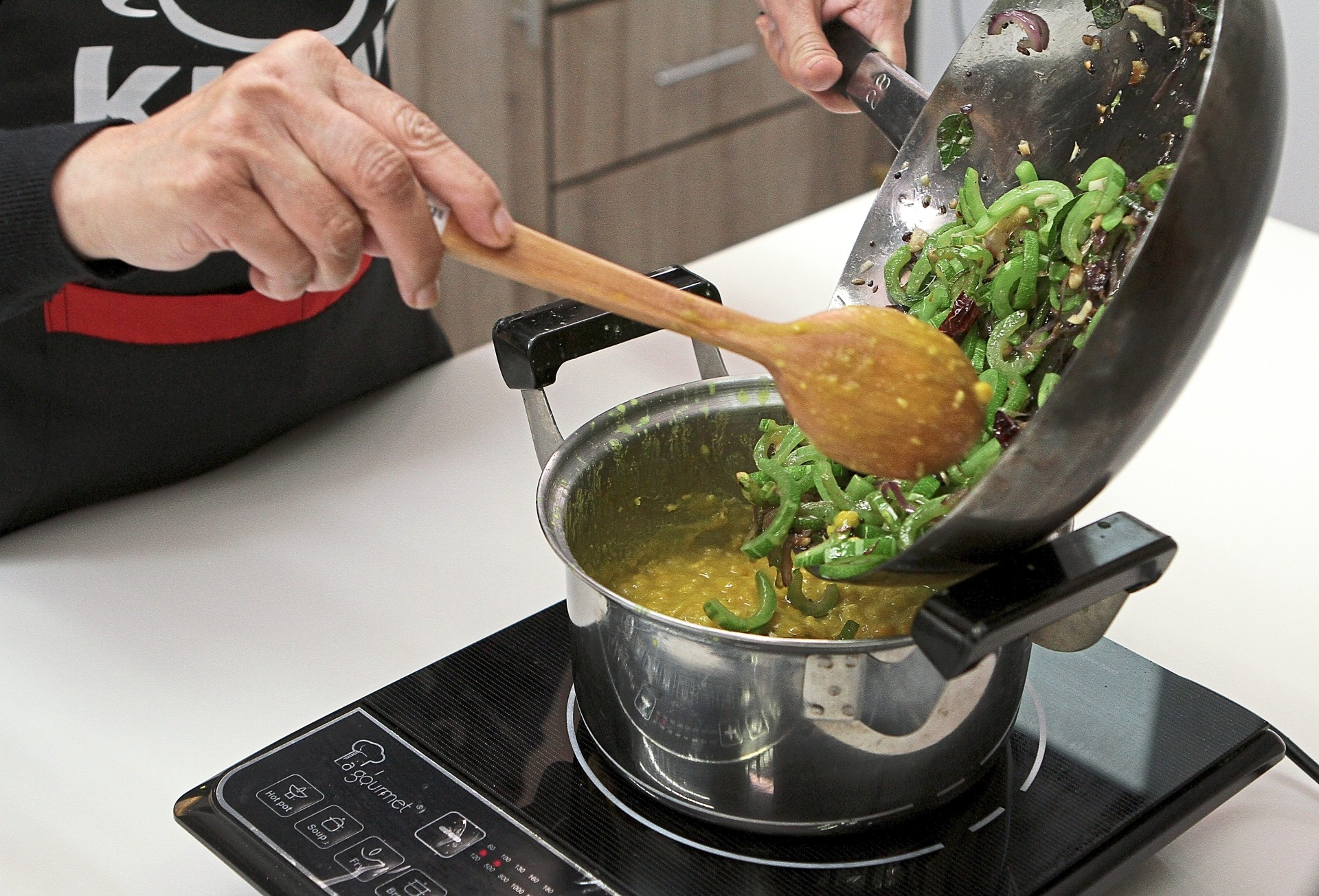 Add the stir-fried snake gourd into the cooked dhal.