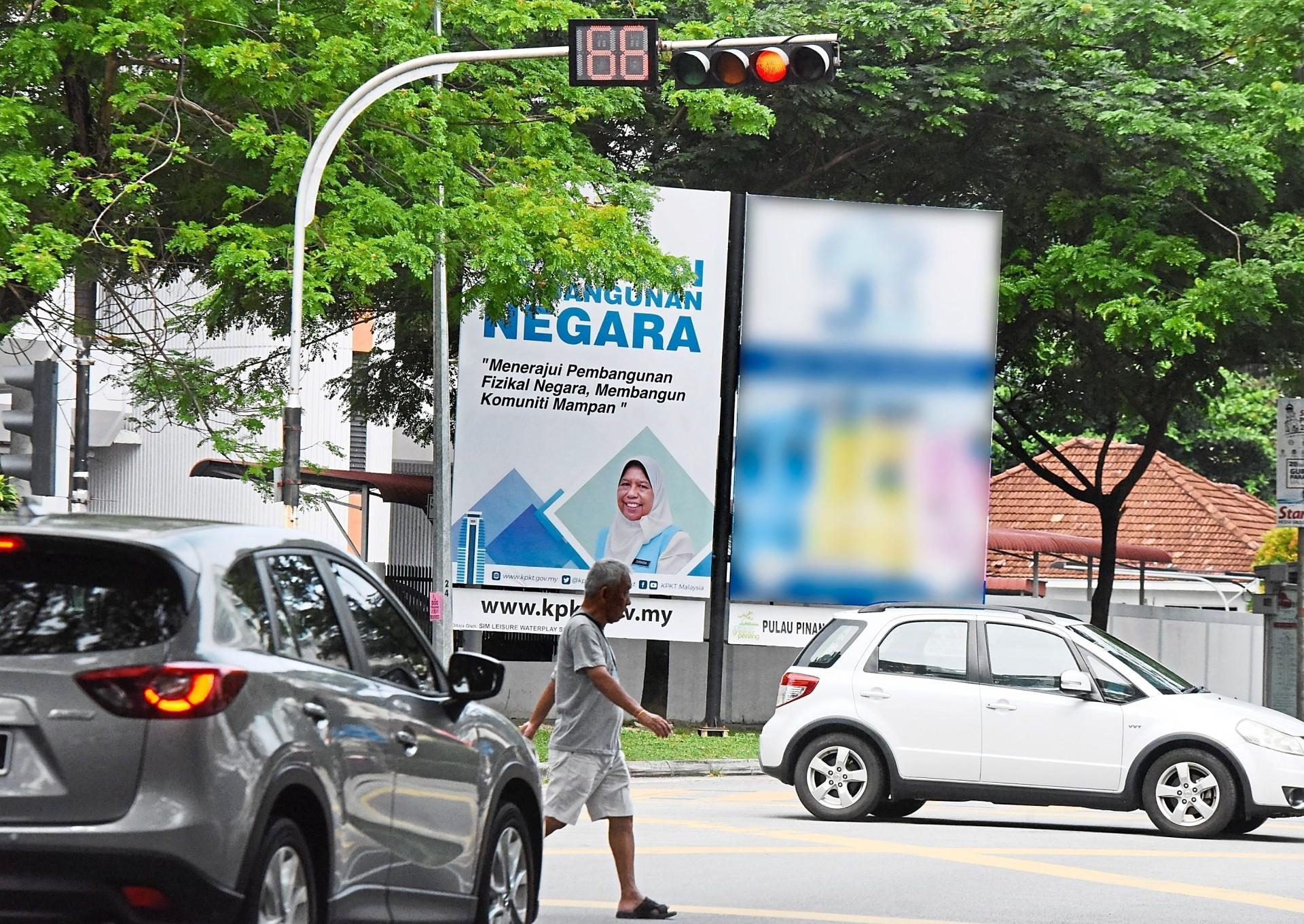 Illegal billboards near the traffic light junction of Jalan Kelawei-Jalan Cantonment in Pulau Tikus. – Photos: MUSTAFA AHMAD/The Star