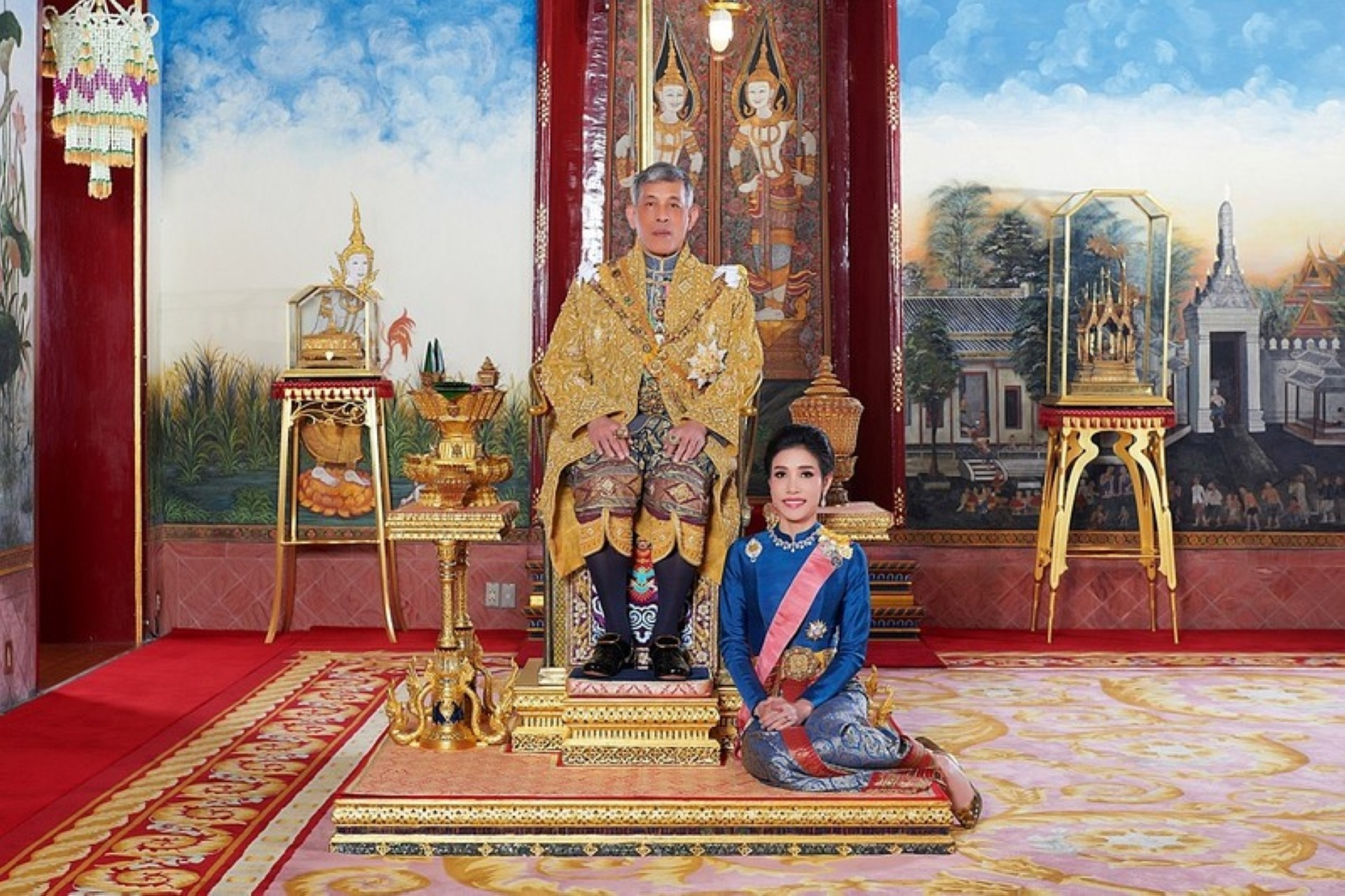 Thailands King Maha Vajiralongkorn and General Sineenat Wongvajirapakdi the royal consort pose at the Grand Palace in Bangkok Thailand  in this undated handout photo obtained by Reuters August 27 2019. Thailands King Maha Vajiralongkorn has stripped his newly named royal consort Sineenat of her titles and military ranks for being quotdisloyalquot and conducting a rivalry with Queen Suthida the palace said late on Monday.   Royal Household BureauHandout via REUTERS
