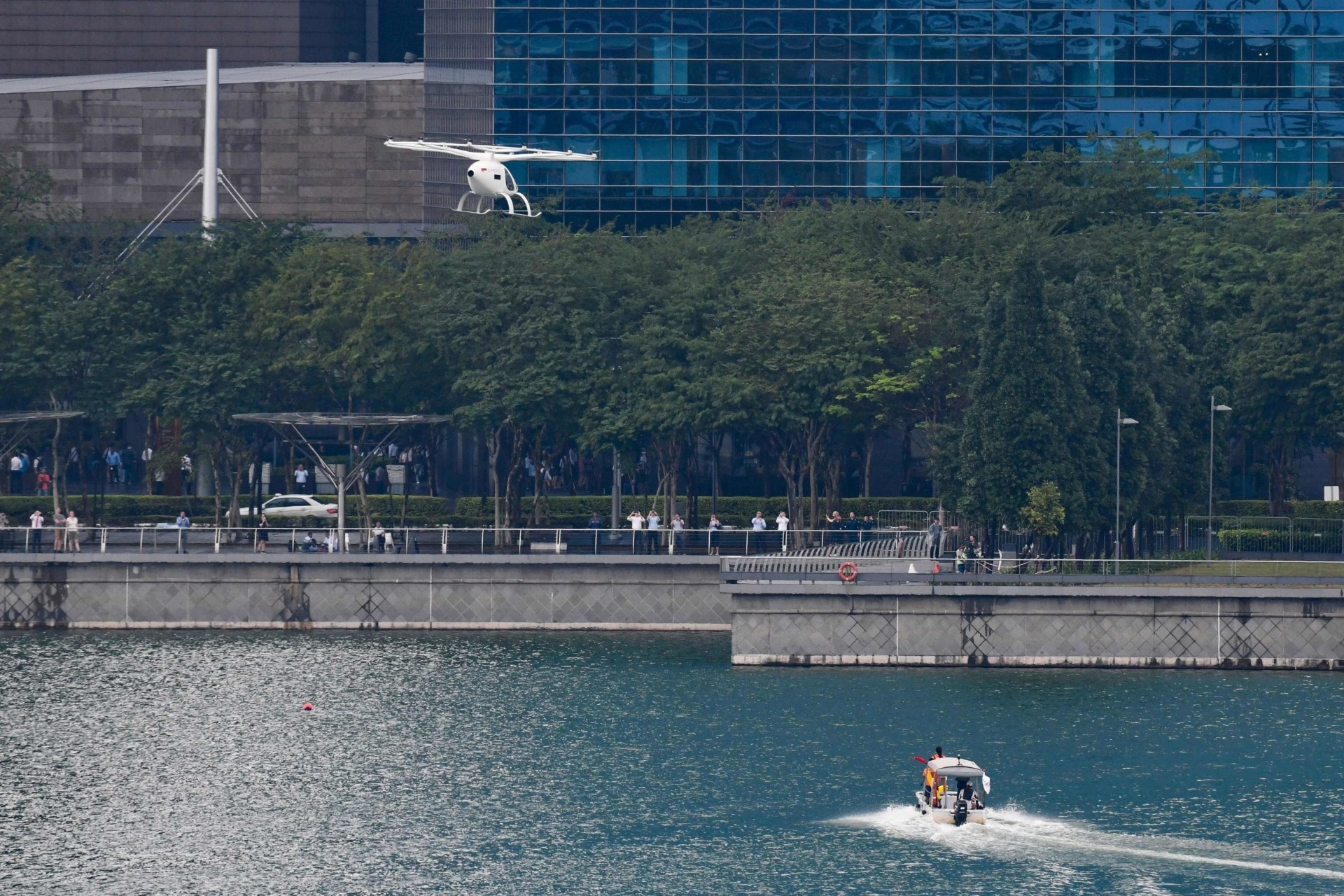 The 18 propeller vehicle, developed by German firm Volocopter and with a pilot onboard during the test flight, took off from a promontory and flew for about two minutes and 30 seconds around the Marina Bay district.