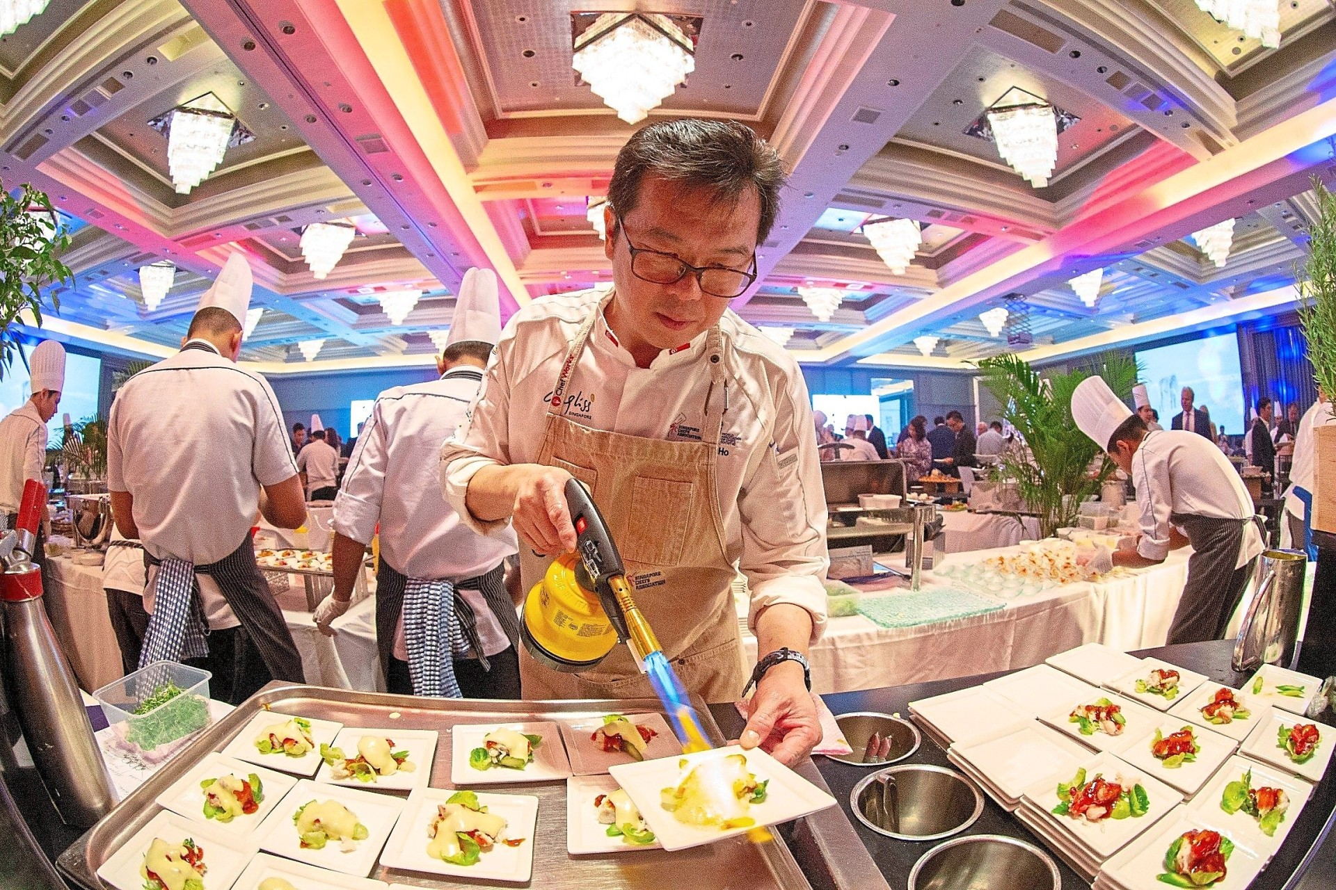 Chef Anderson Ho torching the hollandaise sauce with chilli in the Shelled King Crab Legs.