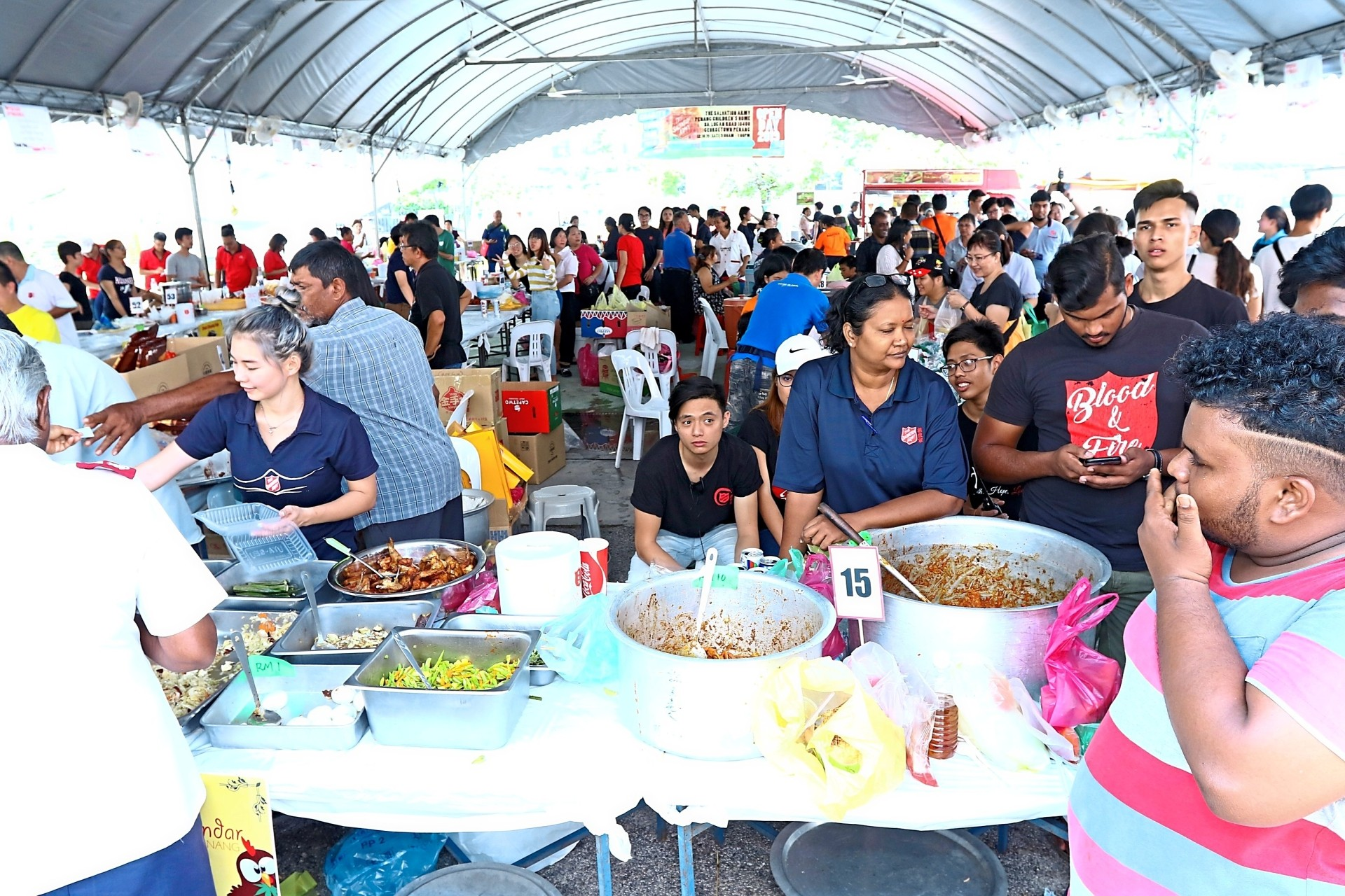 Visitors patronising the food stalls during the Salvation Army's annual open day and charity food fair. — Photos: ZAINUDIN AHAD/The Star