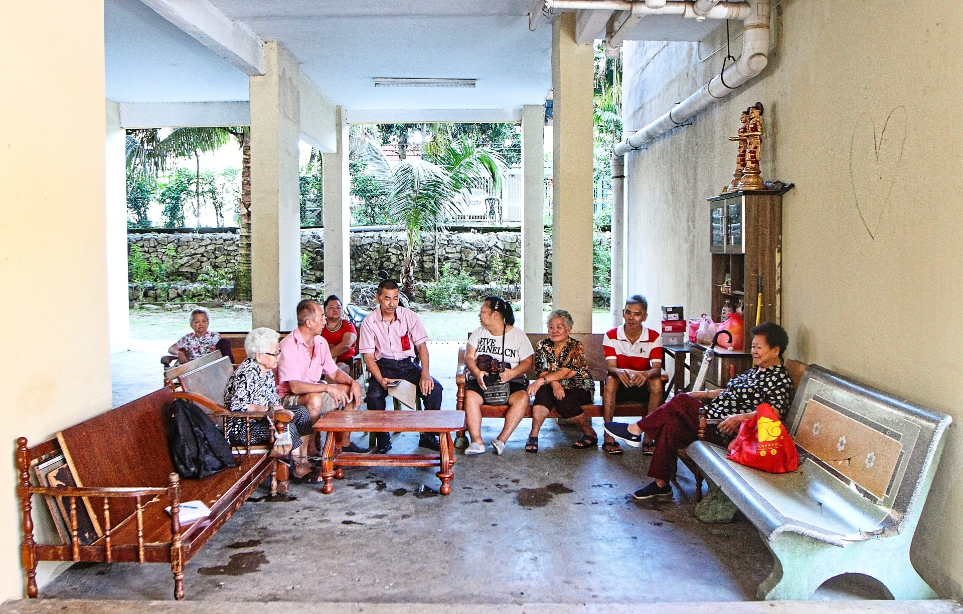 The elderly residents of Pekan Kepong PPR habitually gather at the common area to chat and have tea.