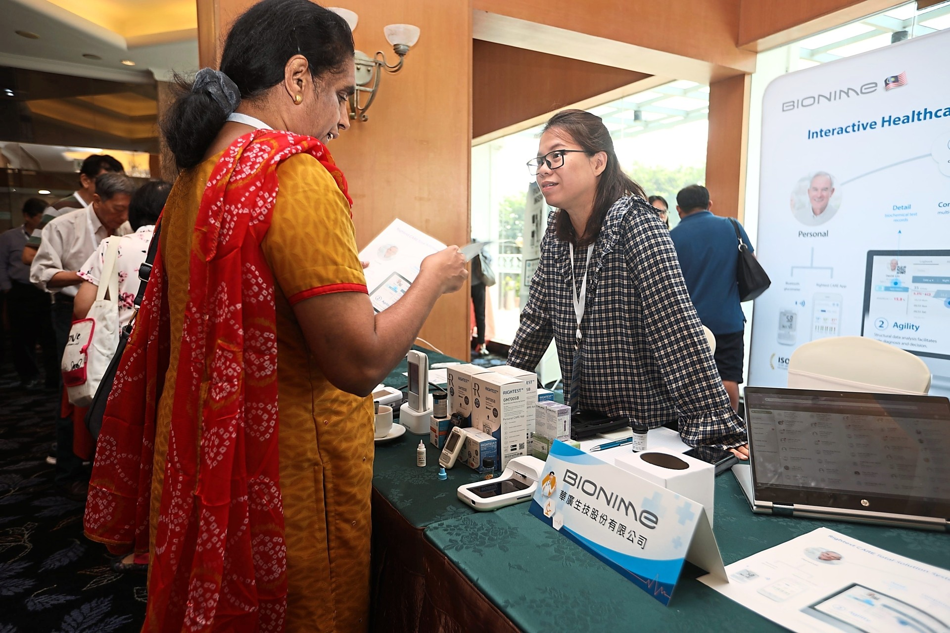 A participant checking out medical equipment at a booth at the International Conference on Integrated Cancer Treatment at Bayview Hotel Georgetown.