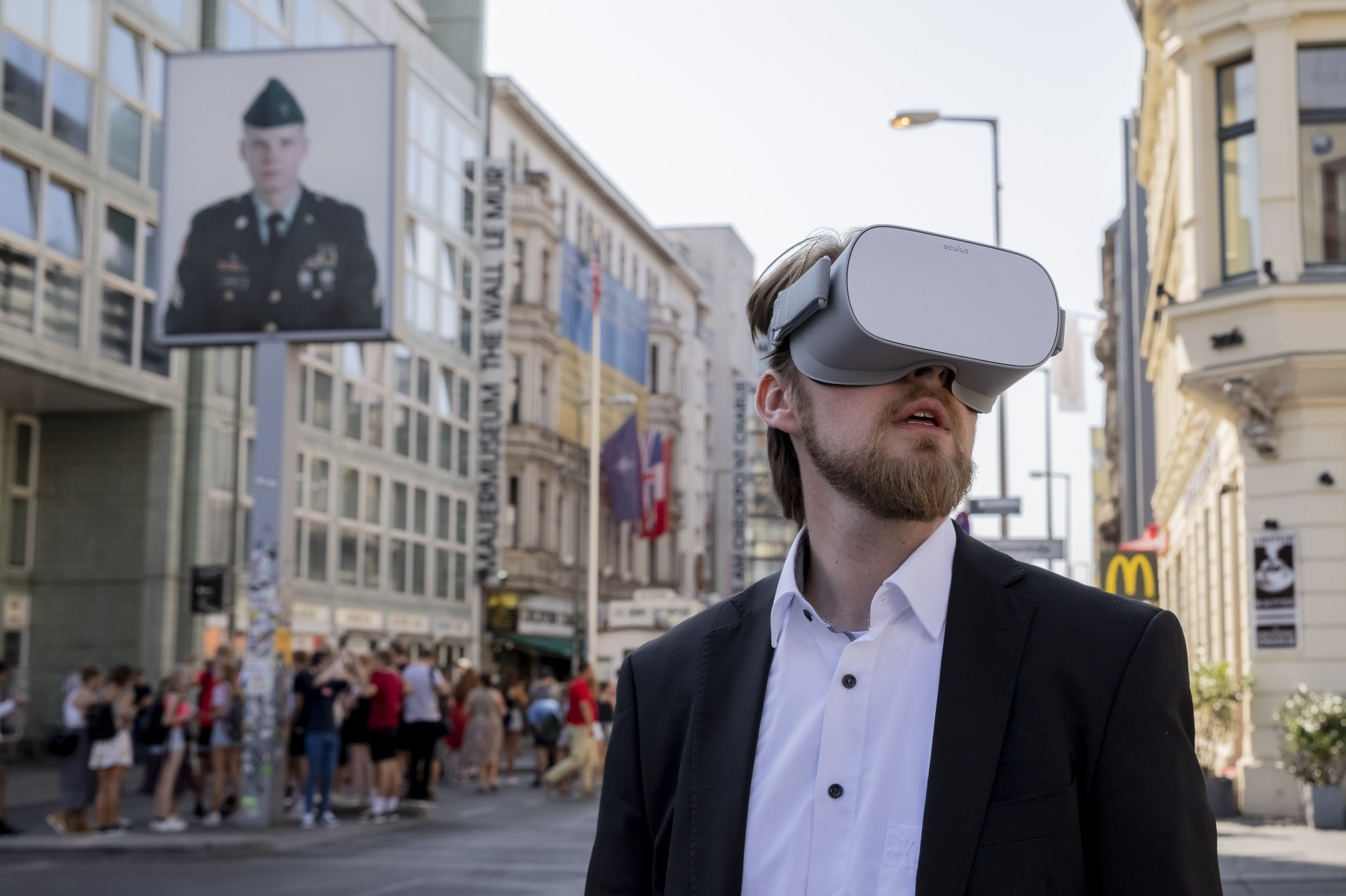 Rothe wearing a VR headset to explore the Berlin streets at Checkpoint Charlie, showing him how it looked like in the 80s cold war in Berlin, Germany. — AP