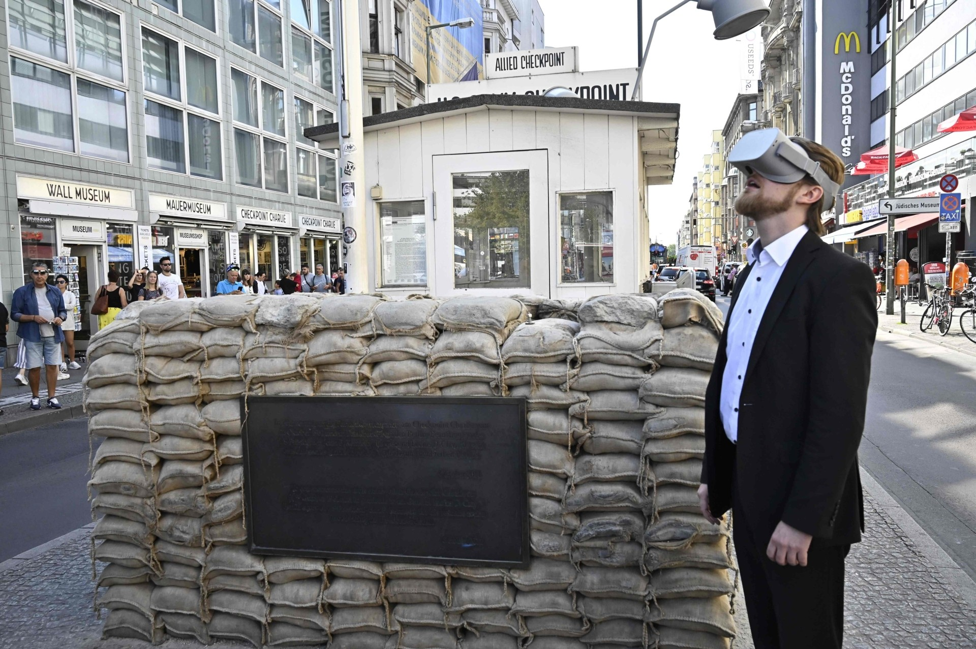 Rothe posing next to Checkpoint Charlie in Berlin.
