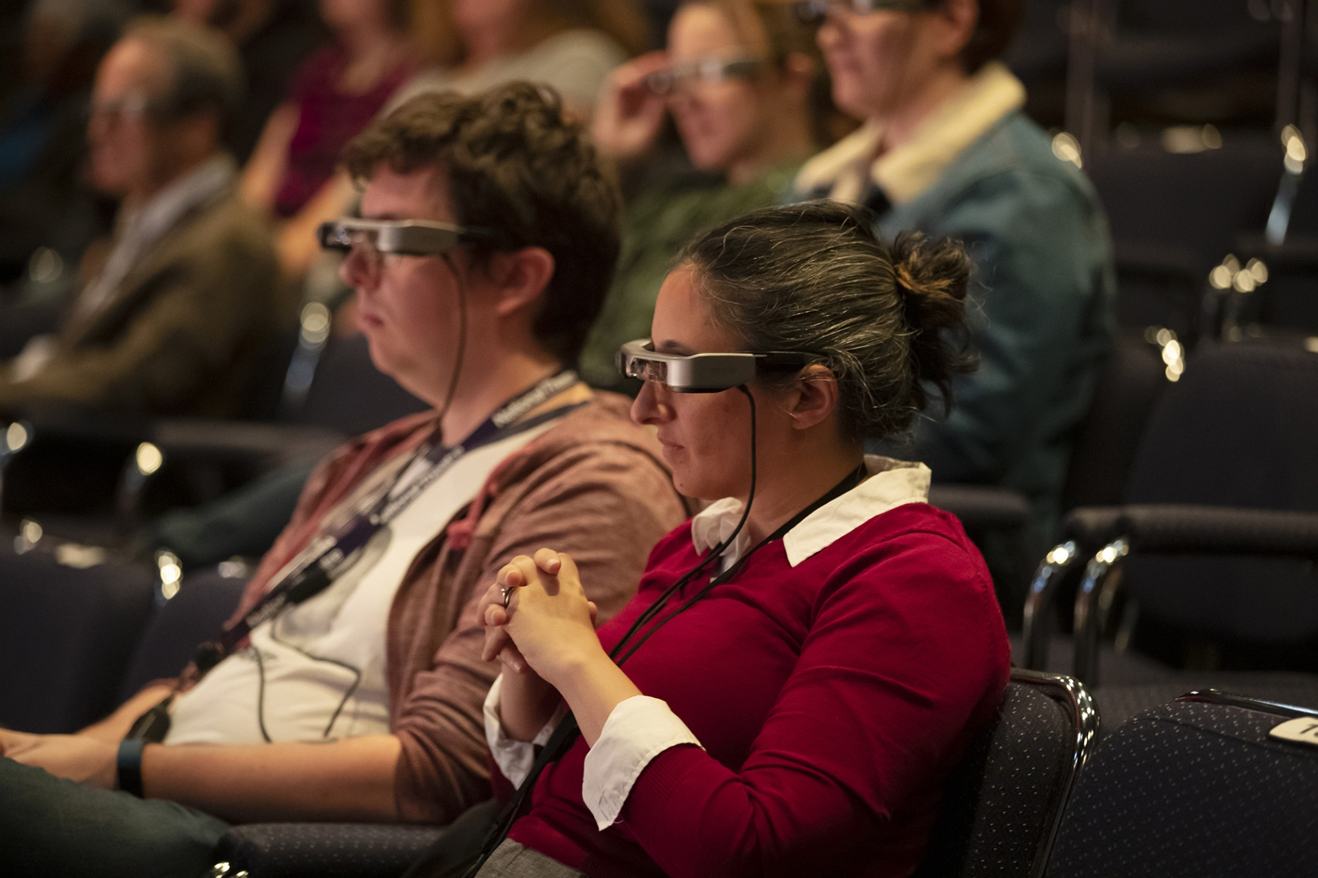Audience members watching a short scene of the play Dot at The People's Light Theater in Malvern, Pa. wearing new caption glasses the theater will provide to patrons with hearing difficulty.