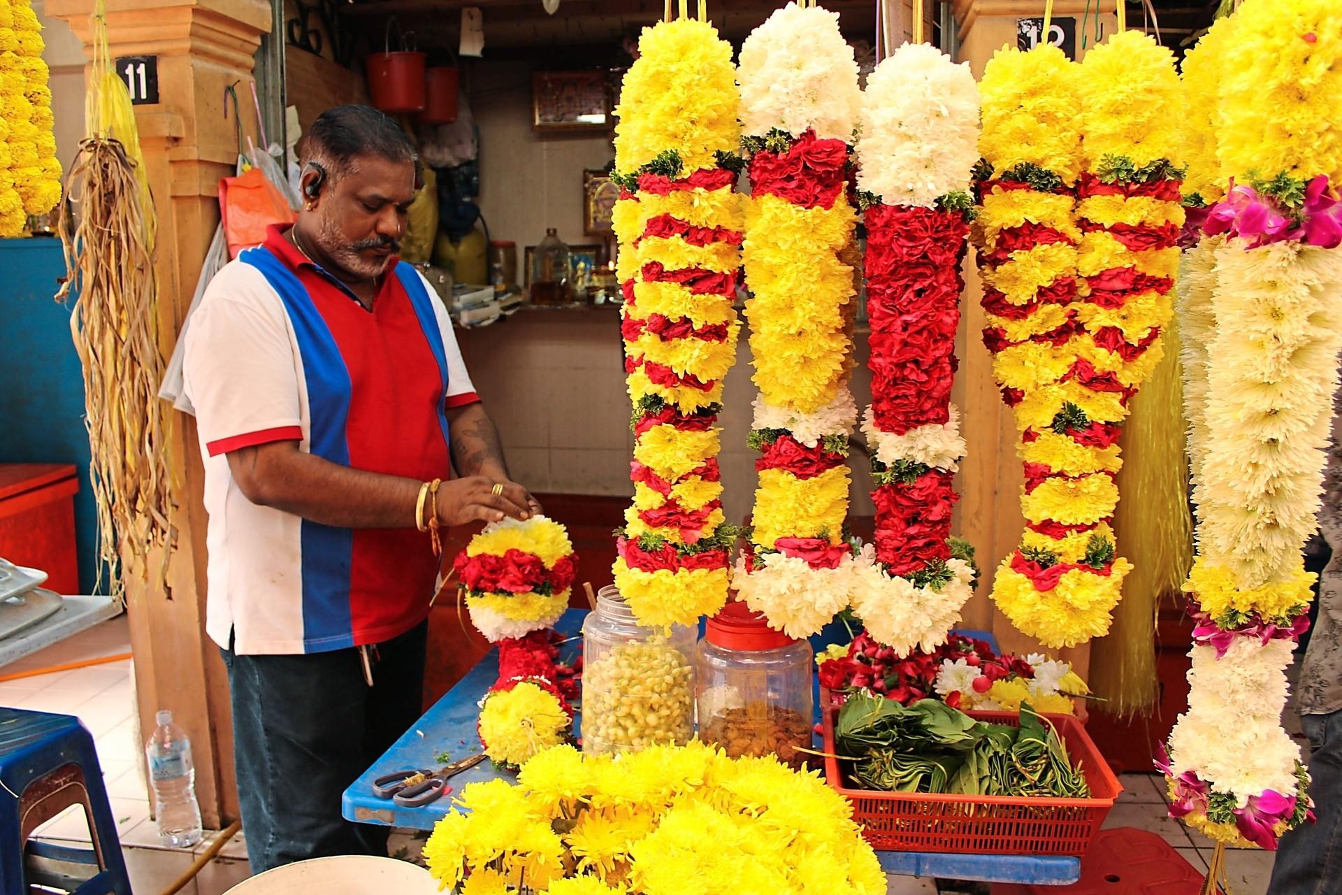 Senthilkumar making garlands at his stall in Wisma Low Kim Her, Brickfields.