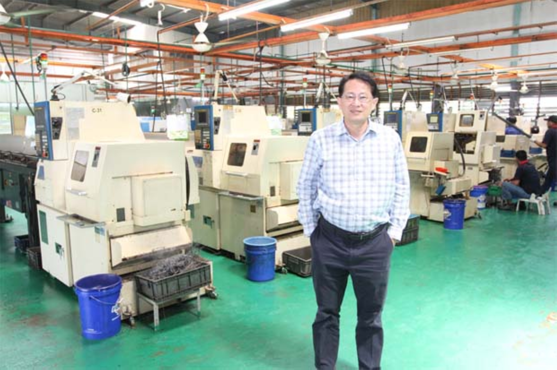 Techfast Holdings Bhd CEO Jason Yap Yoon Sing at the production line. - The Star