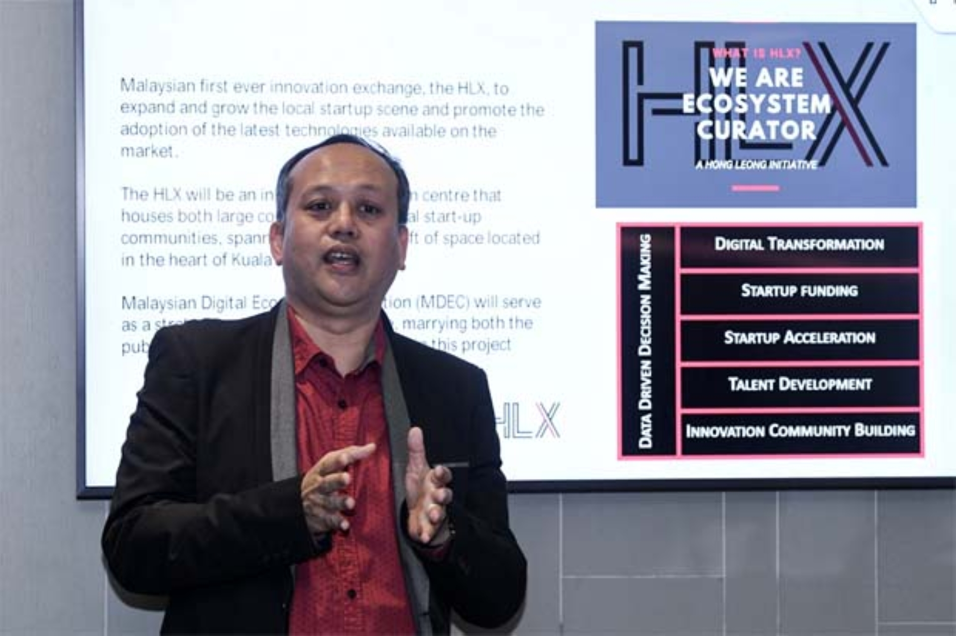 HLXM General Manager Mohd Reezan Mohd Fadzil(pic) speaking during HLX Integrated Innovation Centre Collaboration with KCOM Group in support of Malaysia Digital Transformation press conference yesterday