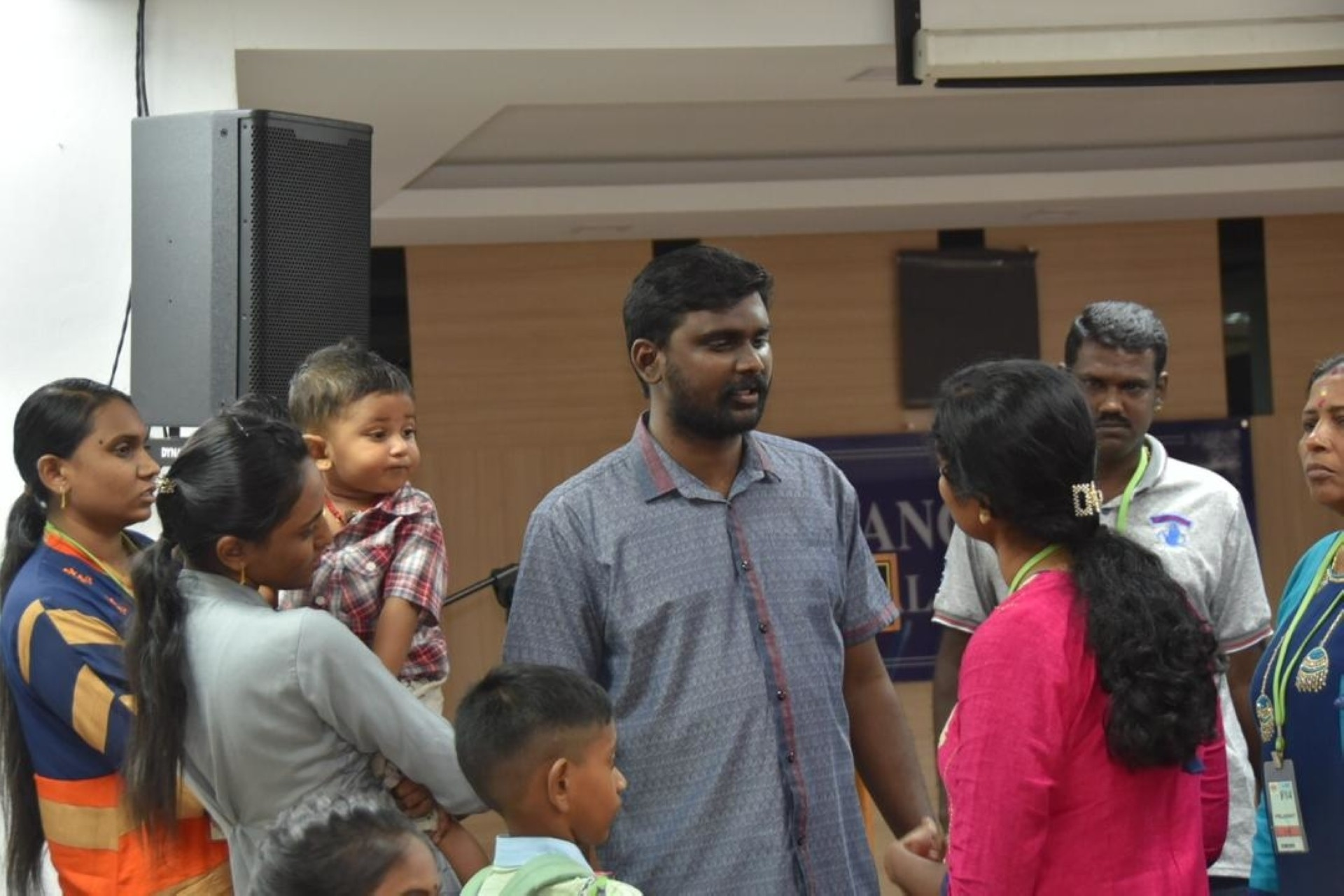 Stay calm: Saminathan (in purple shirt) talking to his family.