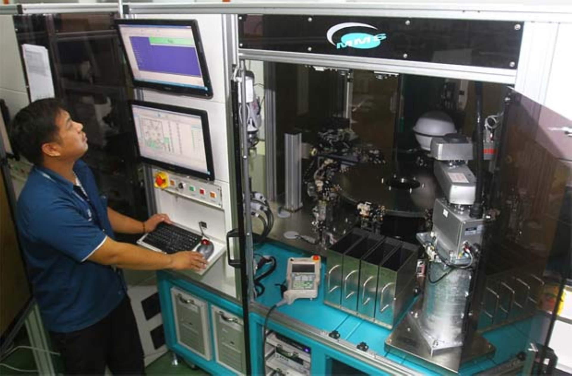 A worker at the MMS Ventures plant in Bayan Lepas checking the test equipment for the automotive and semiconductor industries produced by MMS Ventures. - ZHAFARAN NASIB/The Star(Filepic)