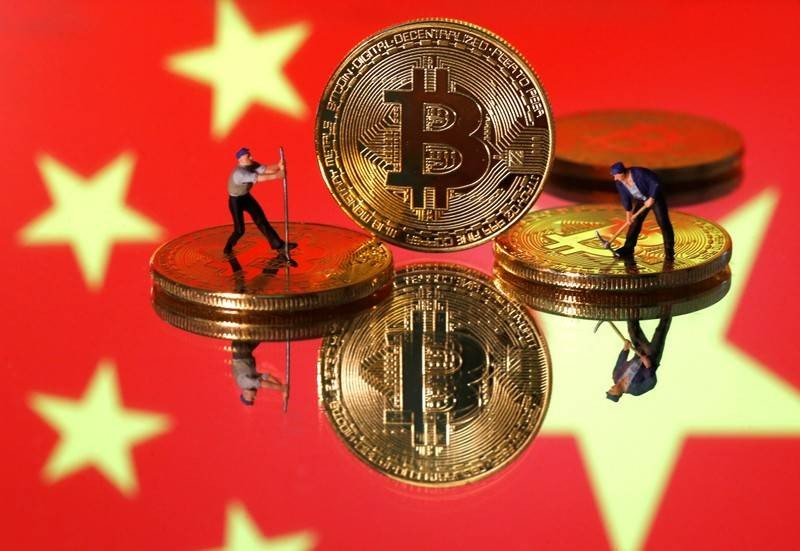 Bitcoin flirts with US$10,000 after China endorses blockchain