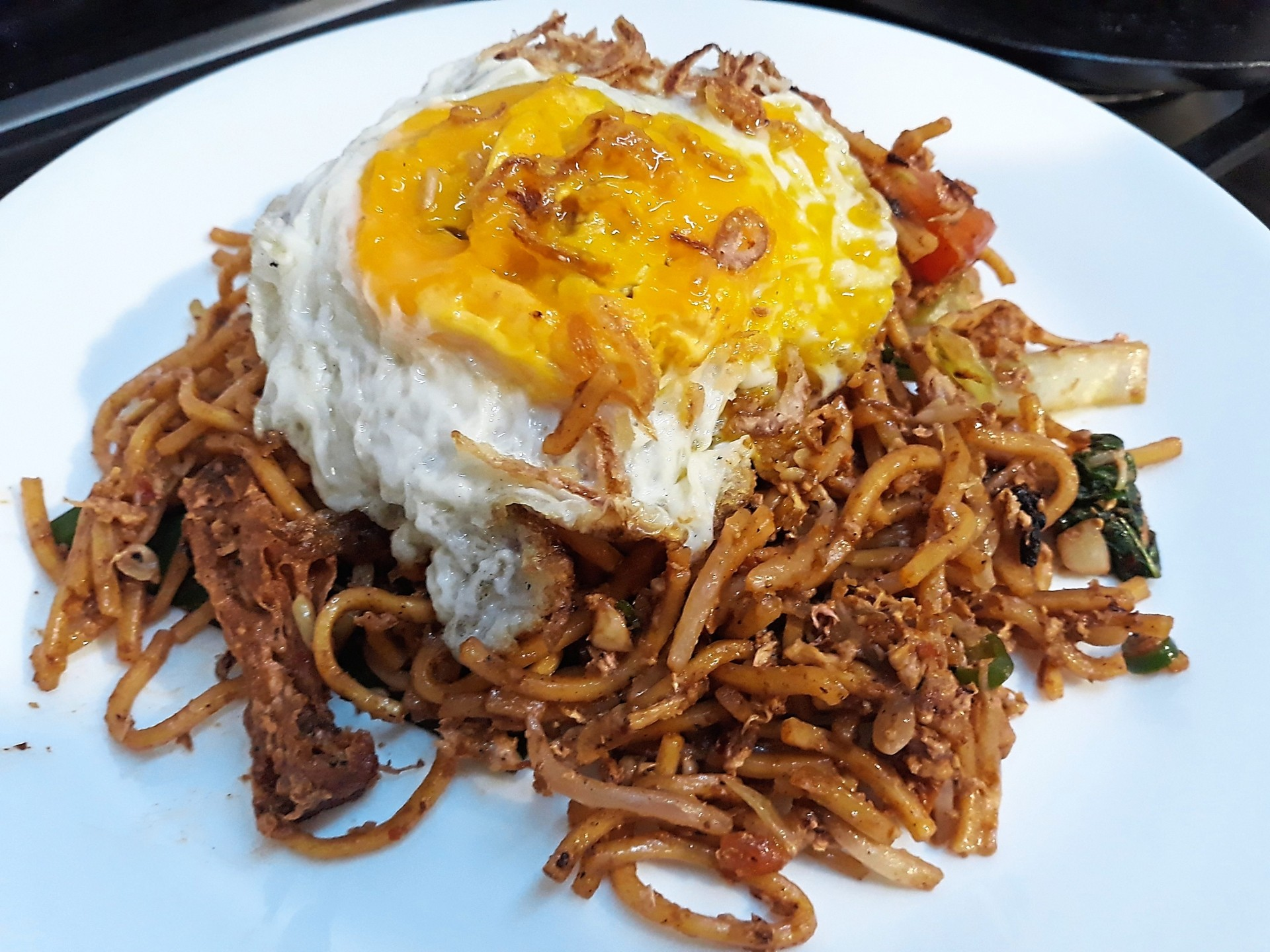 The mee goreng at Cobra Club comes with a good amount of fritters, vegetables and a fried egg.