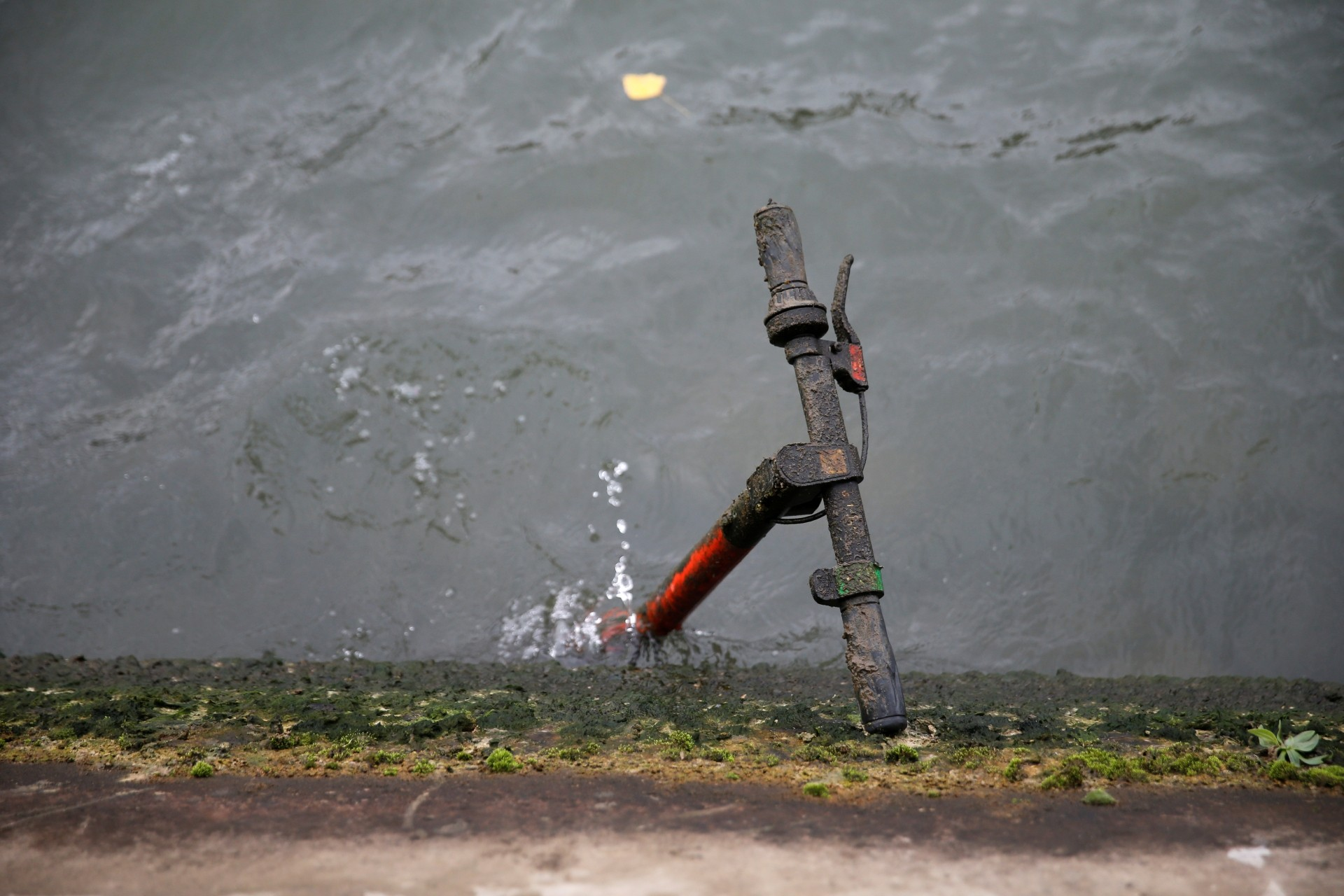 An abandoned electric scooter is seen in the River Seine.